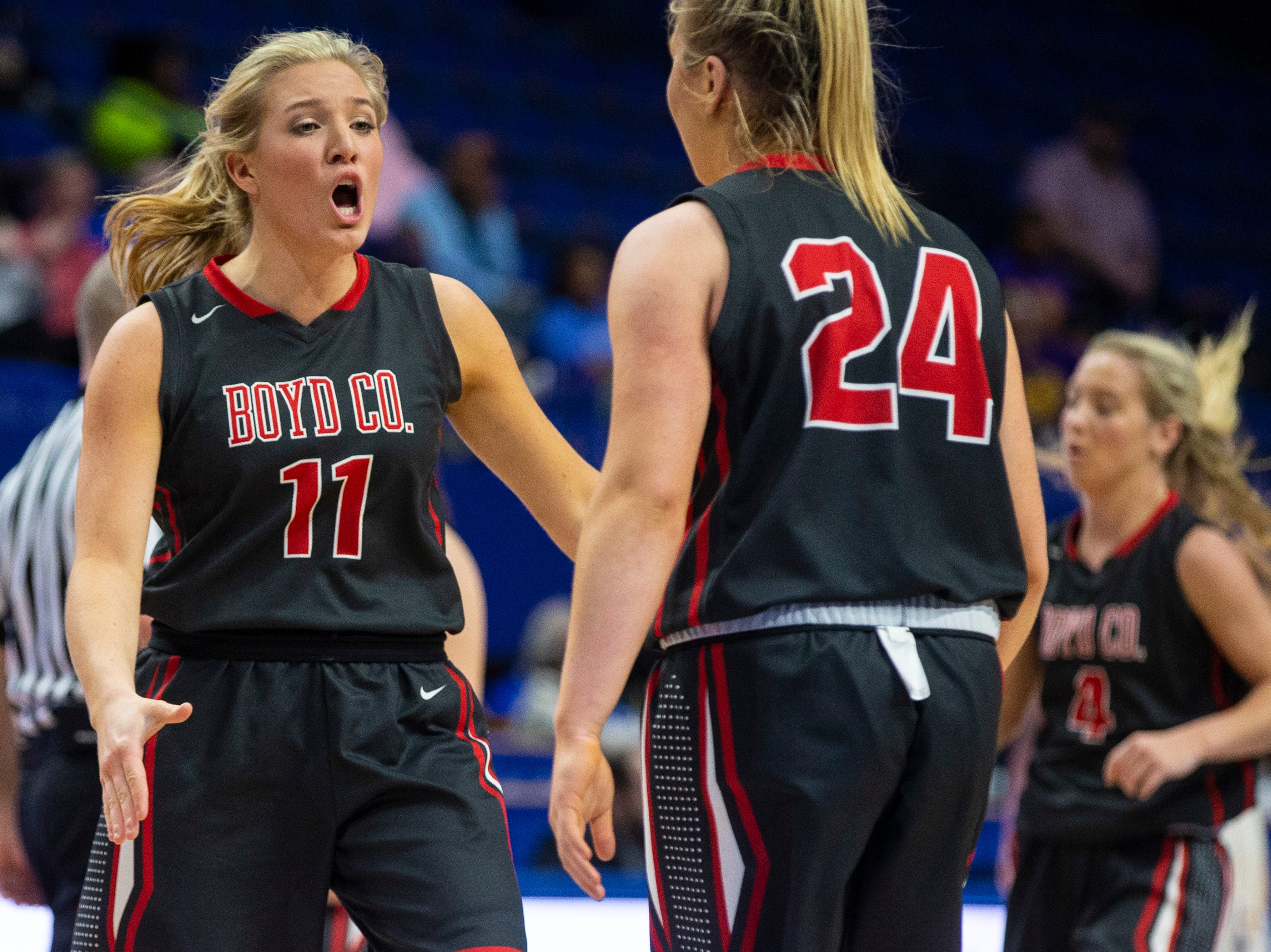 Boyd County's Graci Borders, left, celebrates with Emma Borders as Boyd County took on Louisville Male in the KHSAA state basketball tournament in Rupp Arena. Male eliminated Boyd County 74-56. March 14, 2019