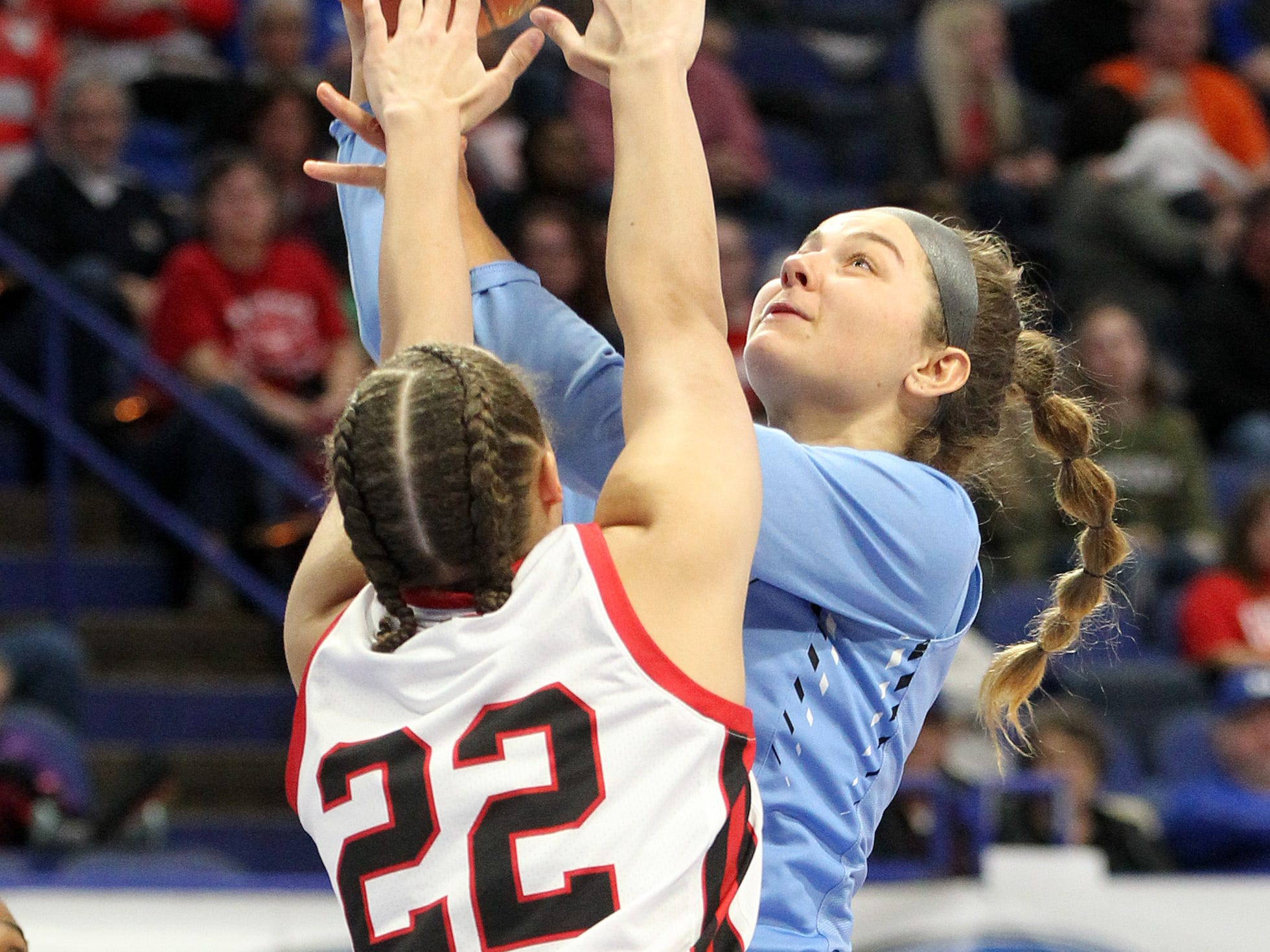 Mercy's Paige Taylor, right, shoots while pressured by George Rogers Clark's Tyra Flowers (22) in their opening round game at the KHSAA Girl's Sweet 16, Wednesday, March 13. George Rogers Clark won 65-64.