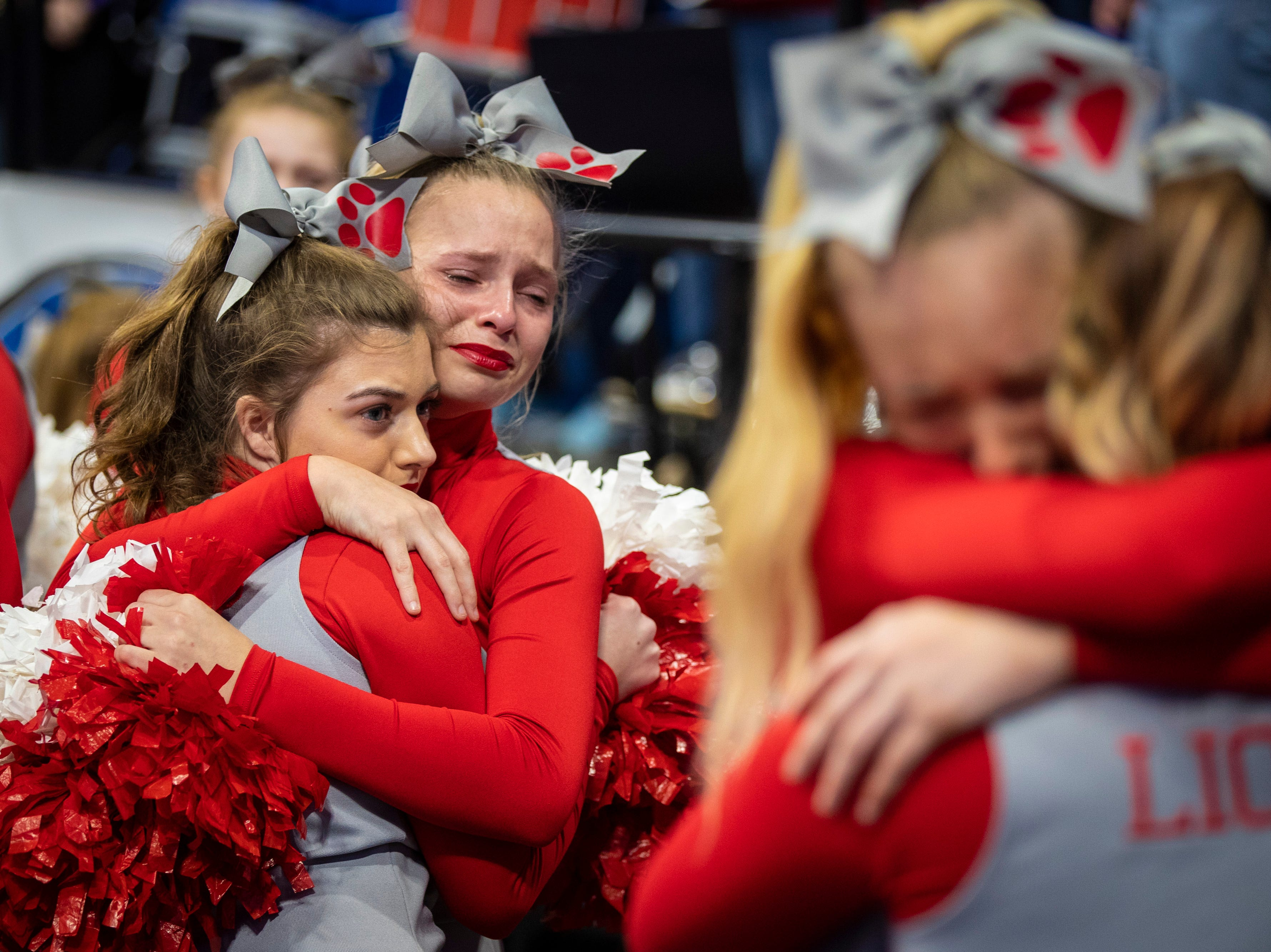 Boyd County cheerleaders react after a loss to Louisville Male in the KHSAA state basketball tournament in Rupp Arena. Male eliminated Boyd County 74-56. March 14, 2019