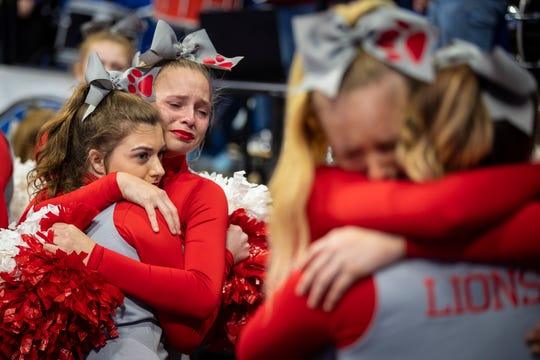 Boyd County cheerleaders react after a loss to Louisville Male in the KHSAA state basketball tournament in Rupp Arena. Male eliminated Boyd County 74-56. March 14, 2019.