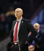 Chris Mack looks on in Louisville's win over Notre Dame.