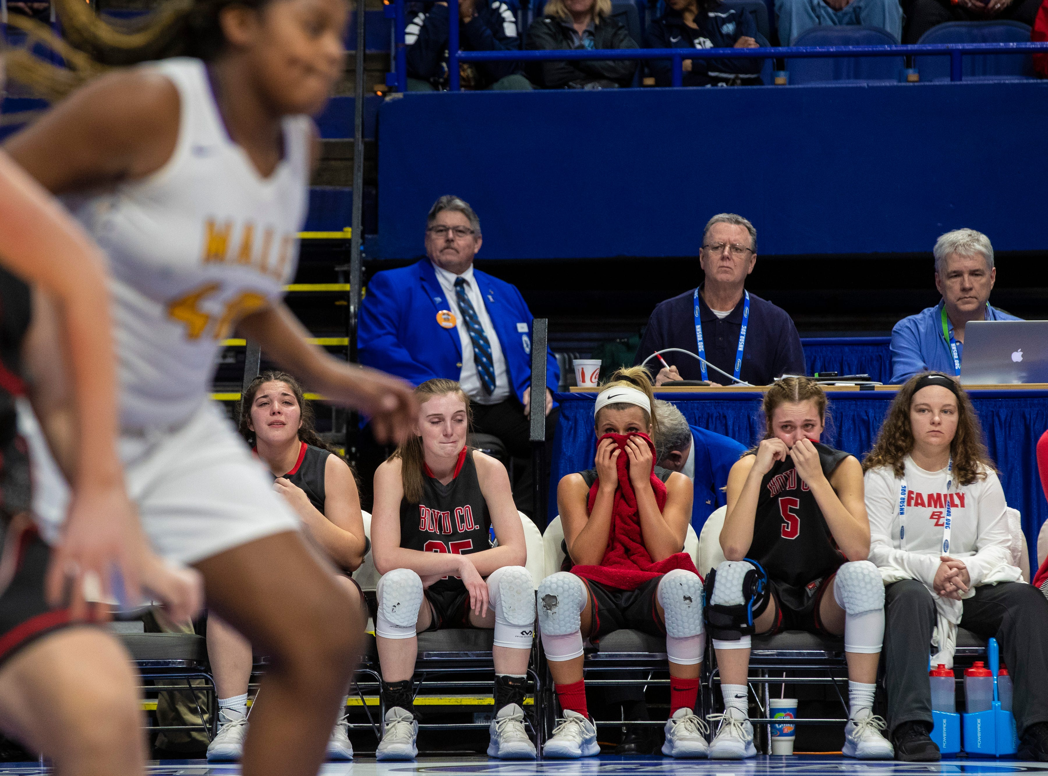 Boyd County players react in the final seconds of the game as Boyd County took on Louisville Male in the KHSAA state basketball tournament in Rupp Arena. Male eliminated Boyd County 74-56. March 14, 2019