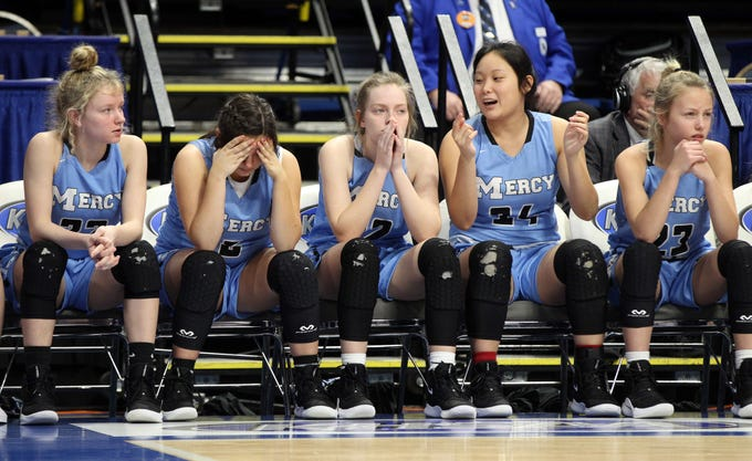 Mercy's bench nervously watches the action in their opening round game against George Rogers Clark at the KHSAA Girl's Sweet 16, Wednesday, March 13. George Rogers Clark won 65-64.