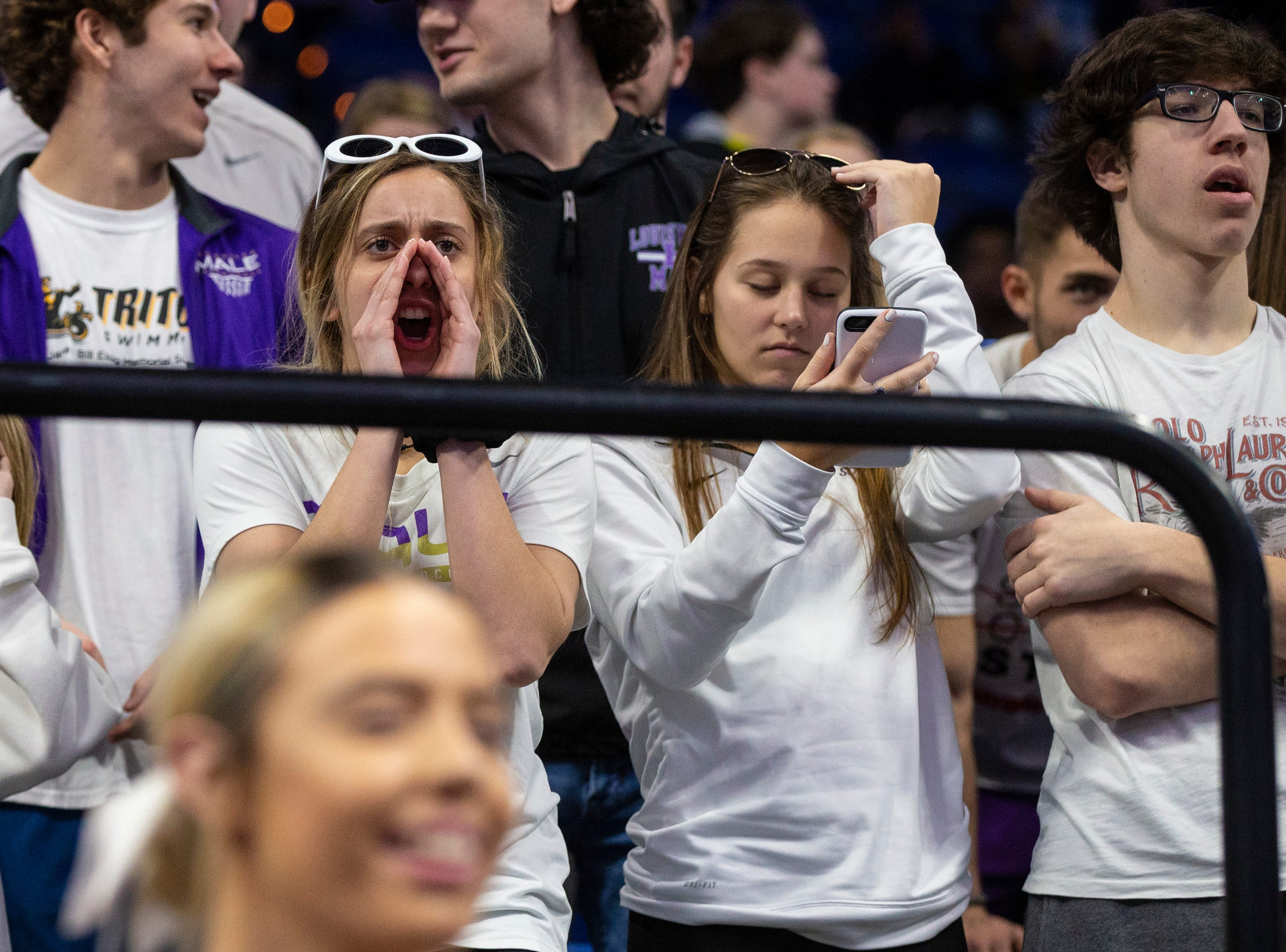 Male fans cheer as Boyd County took on Louisville Male in the KHSAA state basketball tournament in Rupp Arena. Male eliminated Boyd County 74-56. March 14, 2019