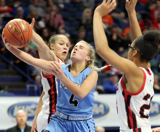 Mercy's Hope Sivori (4) shoots between George Rogers Clark's Tyra Flowers, left, and Brianna Byars in their opening round game at the KHSAA Girl's Sweet 16, Wednesday, March 13. George Rogers Clark won 65-64.