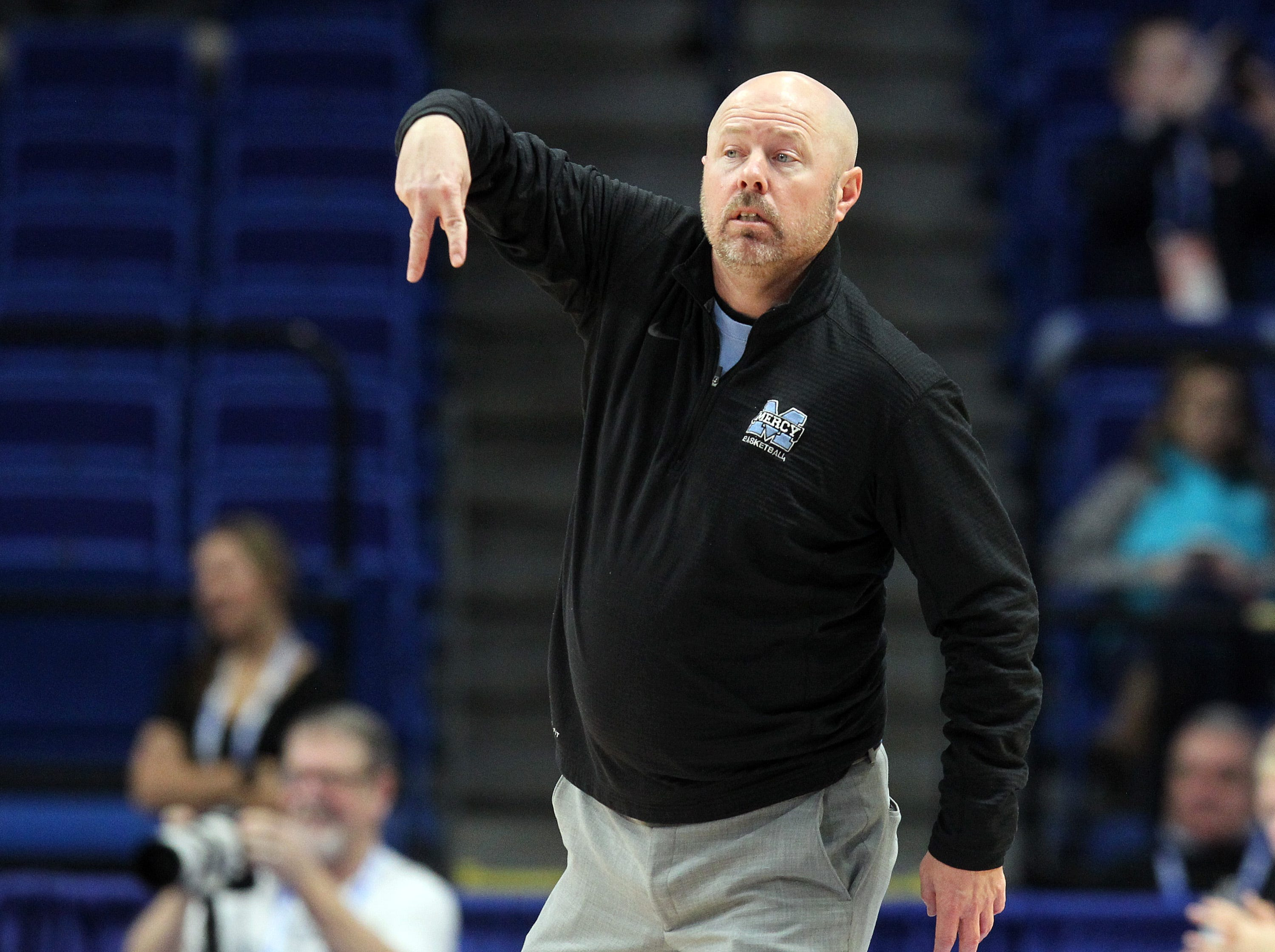 Mercy head coach Keith Baisch calls a play in their opening round game at the KHSAA Girl's Sweet 16, Wednesday, March 13.