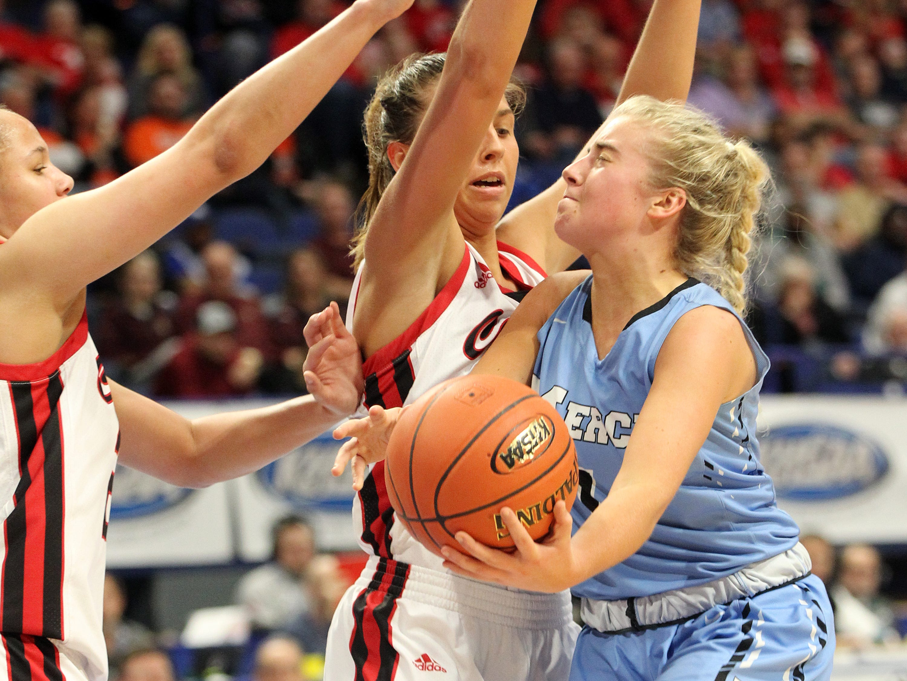 Mercy's Hope Sivori, right, looks for an opening on the George Rogers Clark defense in their opening round game at the KHSAA Girl's Sweet 16, Wednesday, March 13. George Rogers Clark won 65-64.
