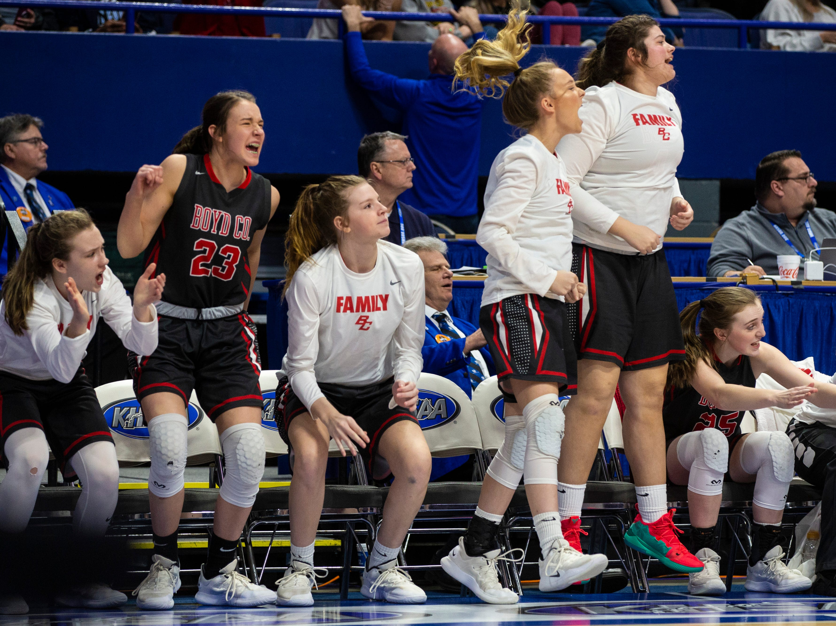 The Boyd County bench celebrates as Boyd County took on Louisville Male in the KHSAA state basketball tournament in Rupp Arena. Male eliminated Boyd County 74-56. March 14, 2019
