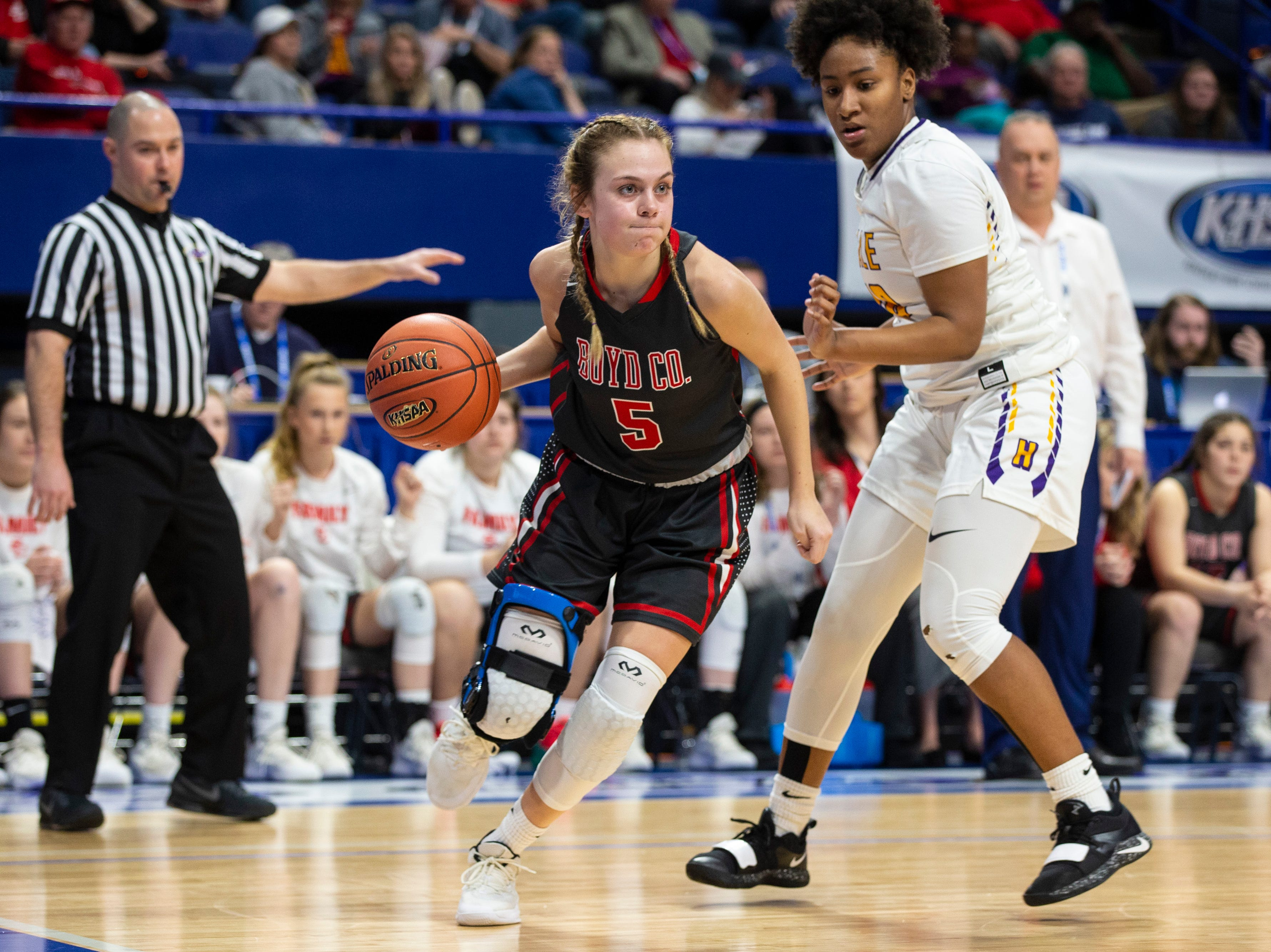 Boyd County's Bailey Rucker moves the ball up the court as Boyd County took on Louisville Male in the KHSAA state basketball tournament in Rupp Arena. Male eliminated Boyd County 74-56. March 14, 2019