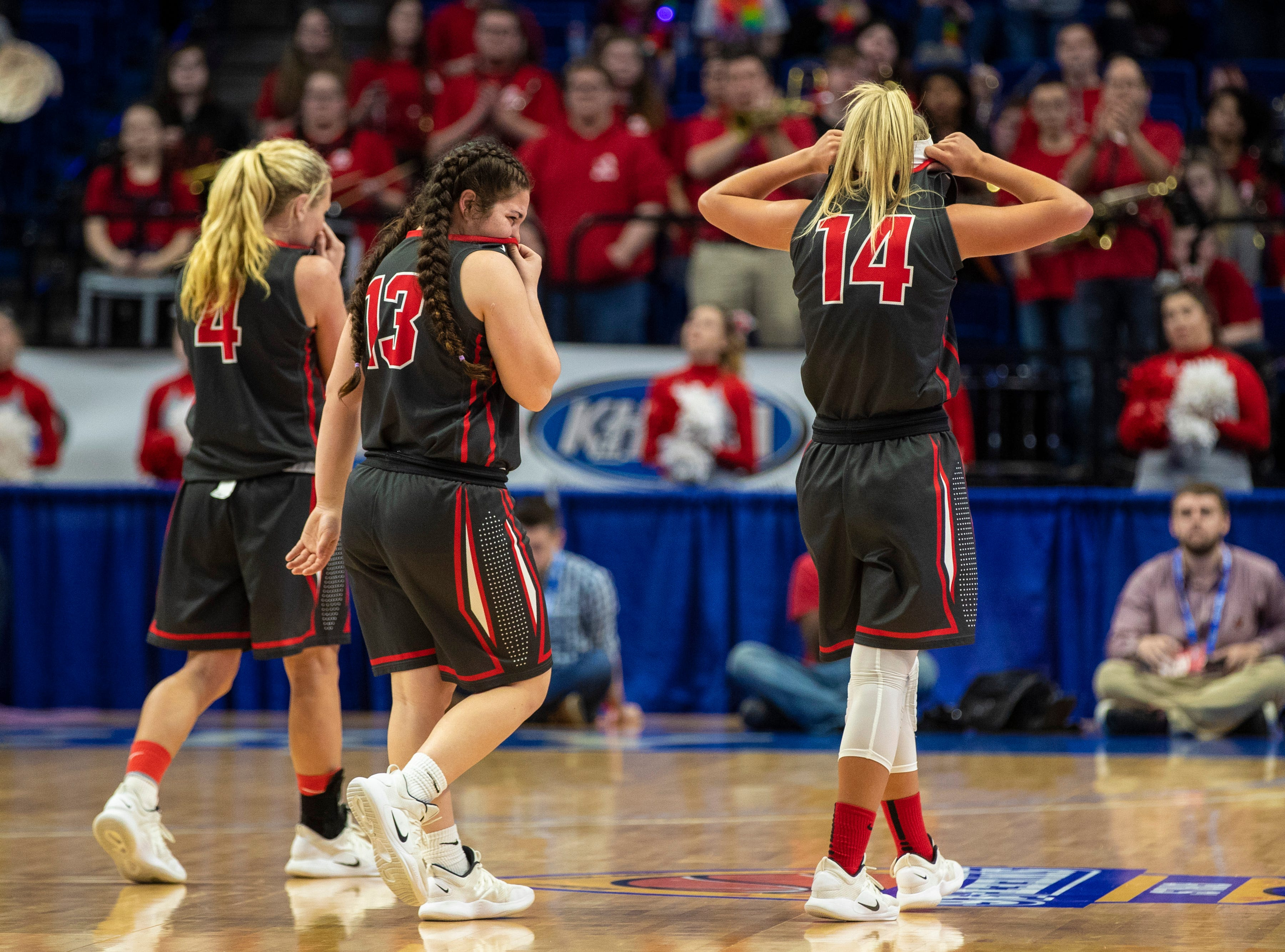 Boyd County's Savannah Wheeler, from left, Graci Opell, and Harley Painter exit the floor as they react to their imminent defeat to Louisville Male in the KHSAA state basketball tournament in Rupp Arena. Male eliminated Boyd County 74-56. March 14, 2019