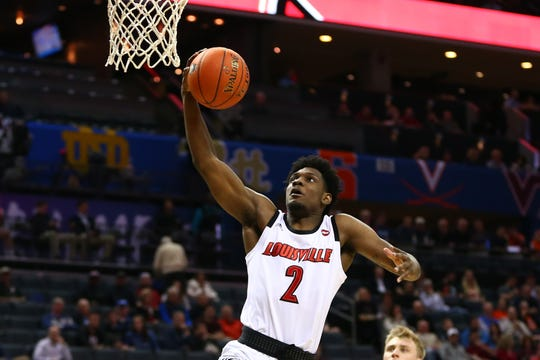 Louisville Cardinals guard Darius Perry (2) goes up for a shot against the Notre Dame Fighting Irish in the first half in the ACC conference tournament at Spectrum Center in Charlotte, North Carolina, on Wednesday, March 13, 2019.