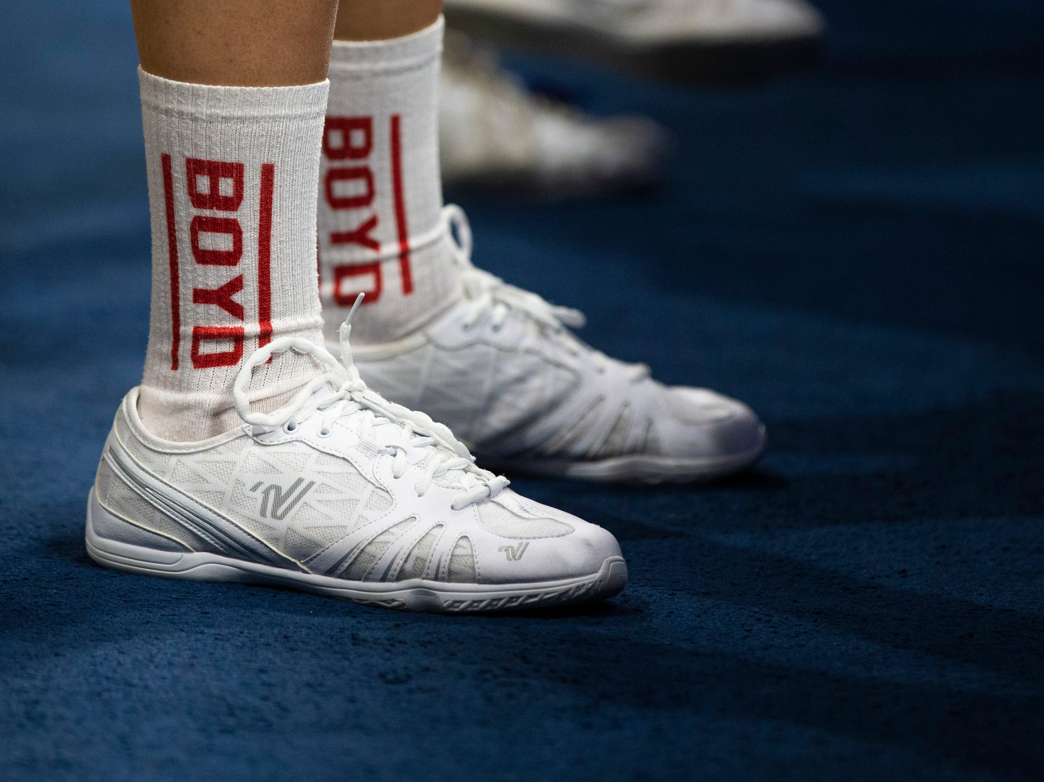 Boyd County cheerleaders wear matching socks as Boyd County took on Louisville Male in the KHSAA state basketball tournament in Rupp Arena. Male eliminated Boyd County 74-56. March 14, 2019