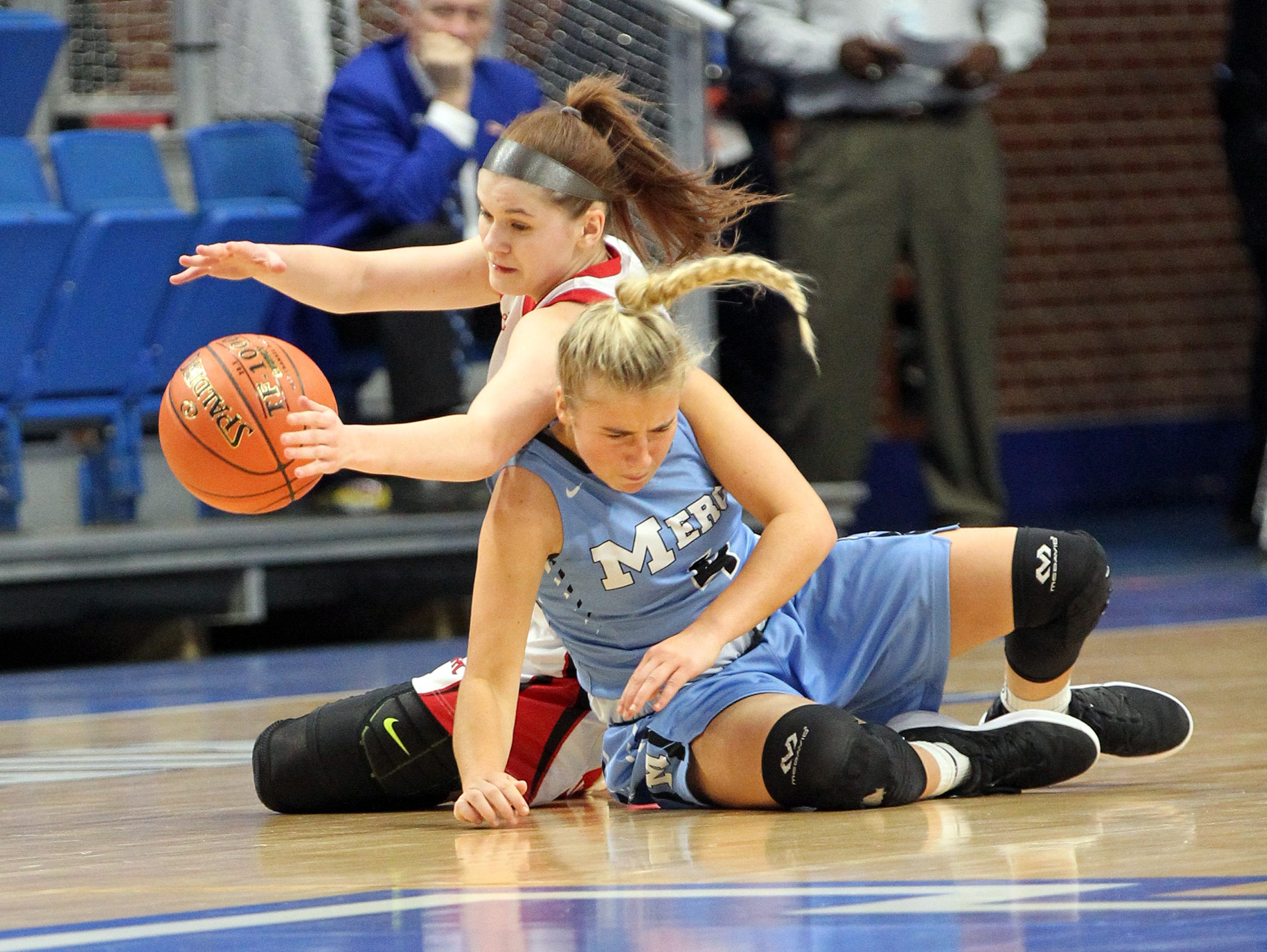 Mercy's Hope Sivori, right, and George Rogers Clark's Kennedy Igo collide in their opening round game at the KHSAA Girl's Sweet 16, Wednesday, March 13.