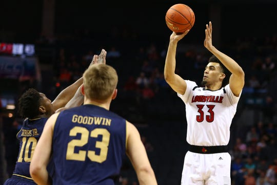 Louisville Cardinals forward Jordan Nwora (33) shoots the ball over Notre Dame Fighting Irish guard TJ Gibbs (10) in the first half in the ACC conference tournament at Spectrum Center in Charlotte, North Carolina, on Wednesday, March 13, 2019.