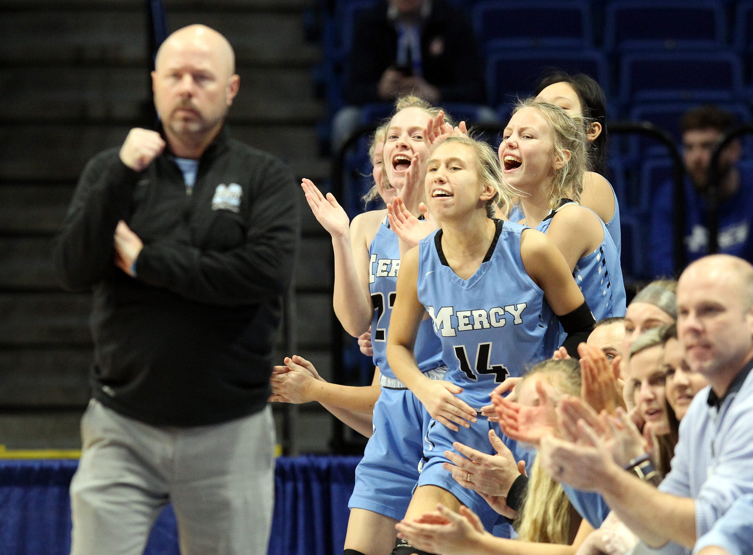 Mercy's bench reacts to a play in their opening round game against George Rogers Clark at the KHSAA Girl's Sweet 16, Wednesday, March 13.