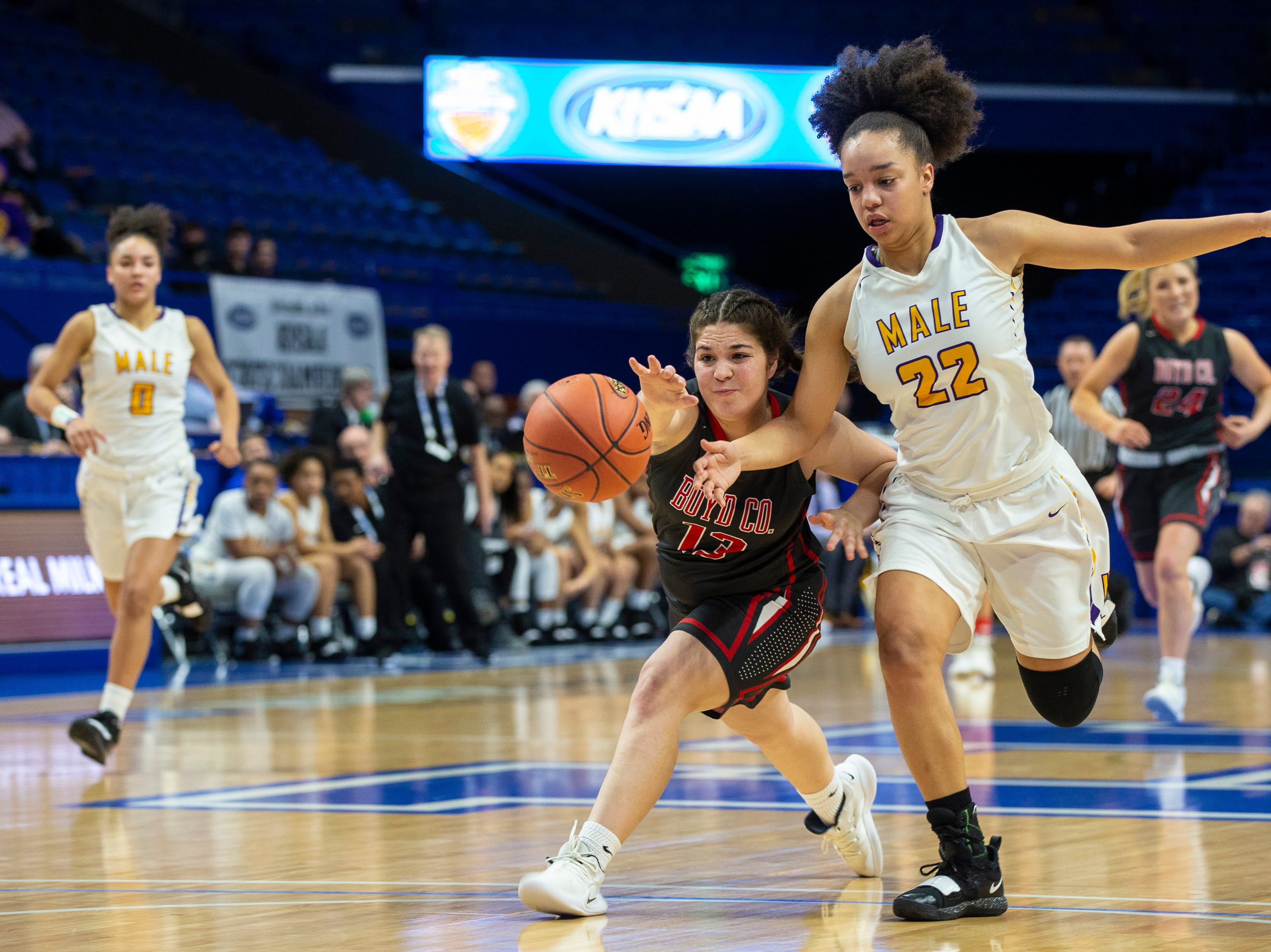 Boyd County's Graci Opell, left, fights for a loose ball with Male's Alana Striverson as Boyd County took on Louisville Male in the KHSAA state basketball tournament in Rupp Arena. Male eliminated Boyd County 74-56. March 14, 2019