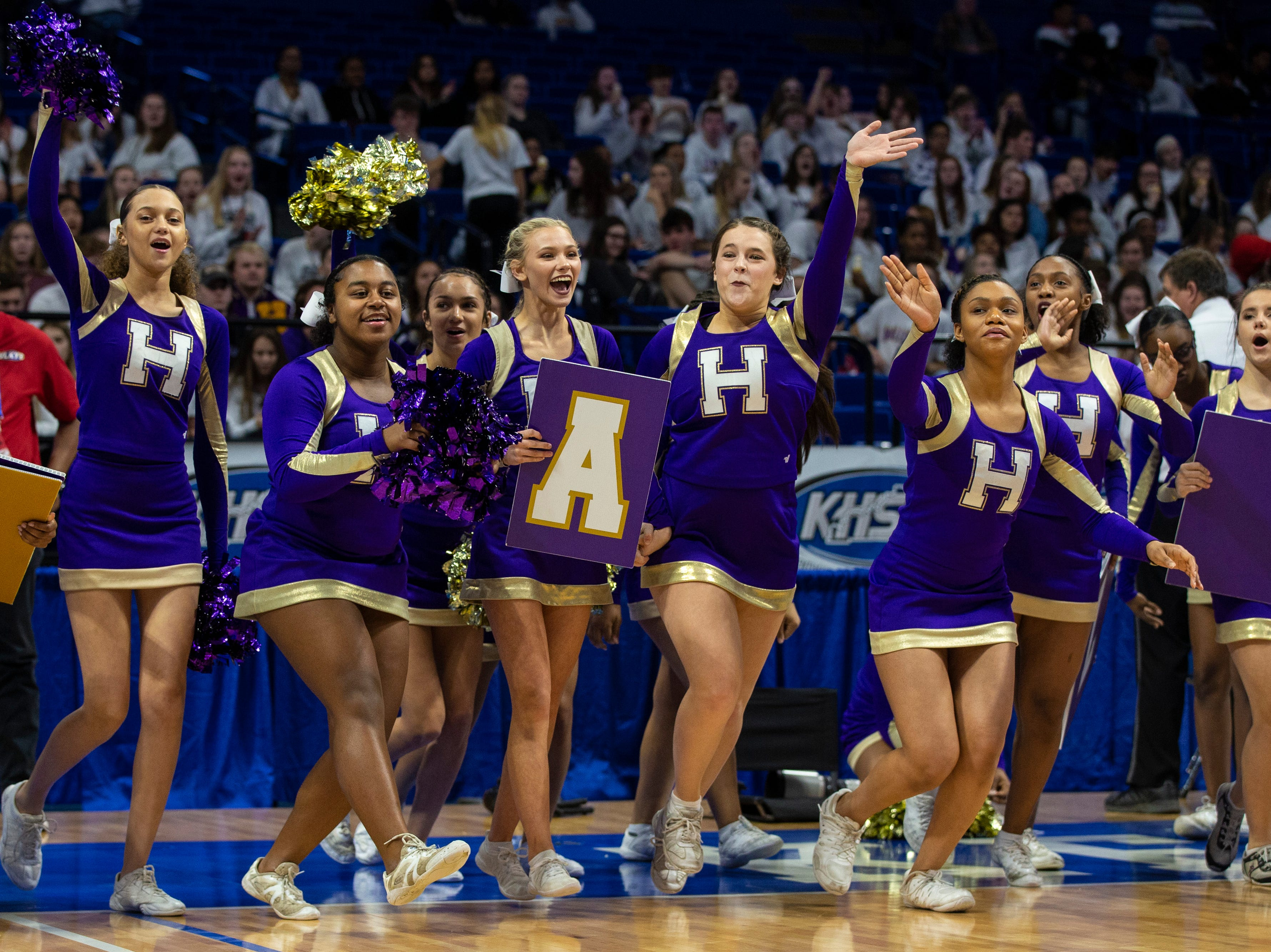 Male cheerleaders perform during halftime as Boyd County took on Louisville Male in the KHSAA state basketball tournament in Rupp Arena. Male eliminated Boyd County 74-56. March 14, 2019