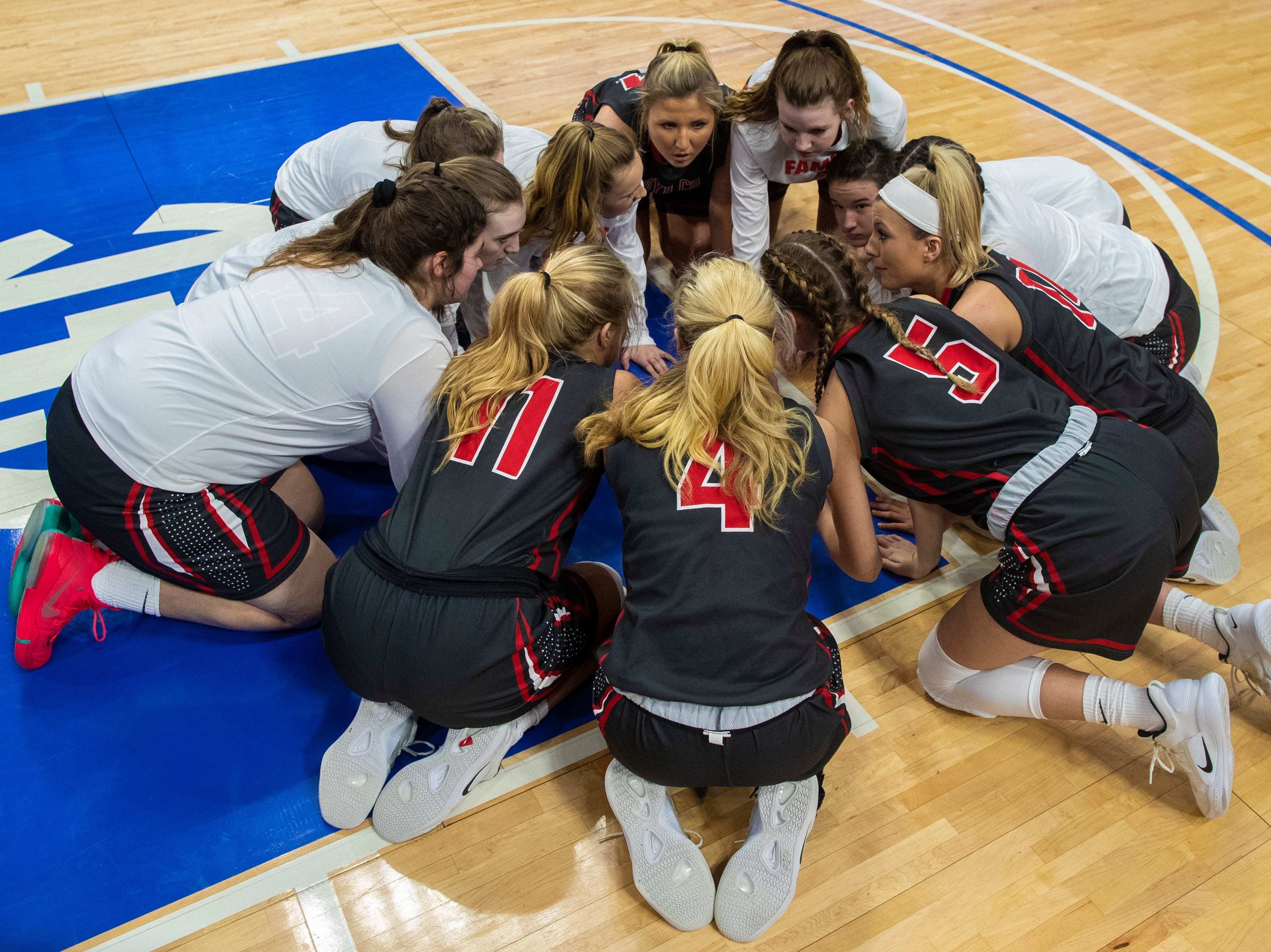 Boyd County players huddle at the start of the game as Boyd County took on Louisville Male in the KHSAA state basketball tournament in Rupp Arena. Male eliminated Boyd County 74-56. March 14, 2019