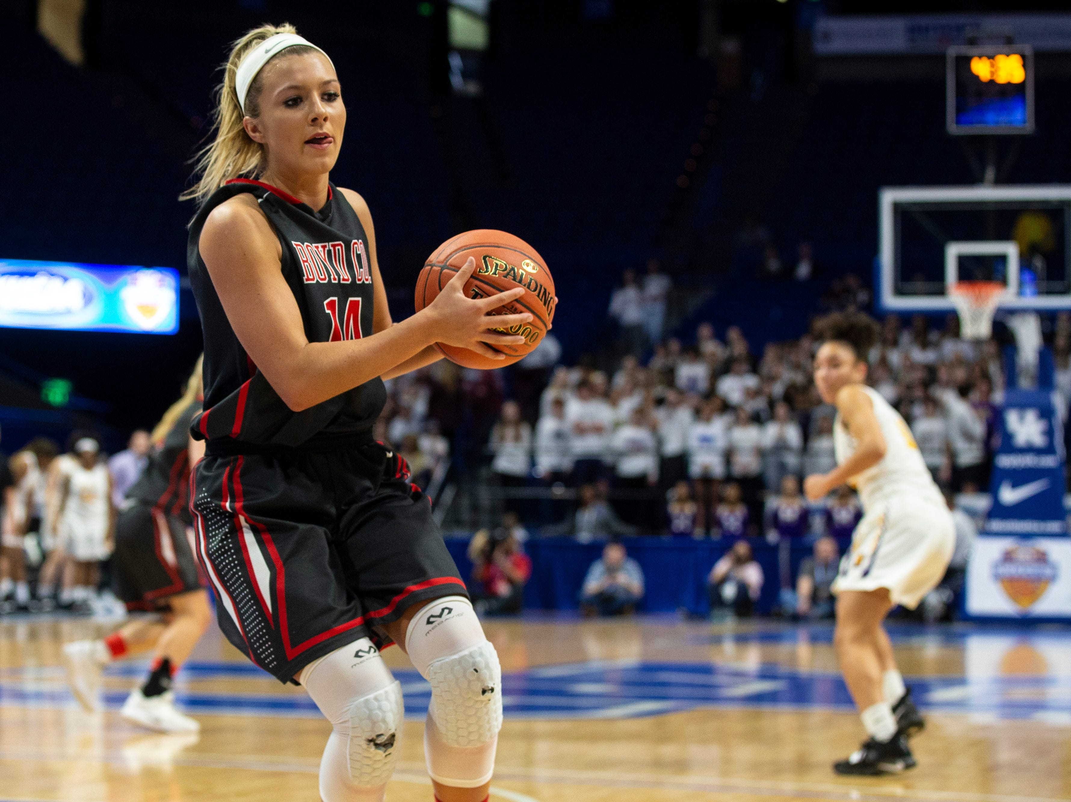 Boyd County's Harley Painter prepares to bring the ball up the floor as Boyd County took on Louisville Male in the KHSAA state basketball tournament in Rupp Arena. Male eliminated Boyd County 74-56. March 14, 2019