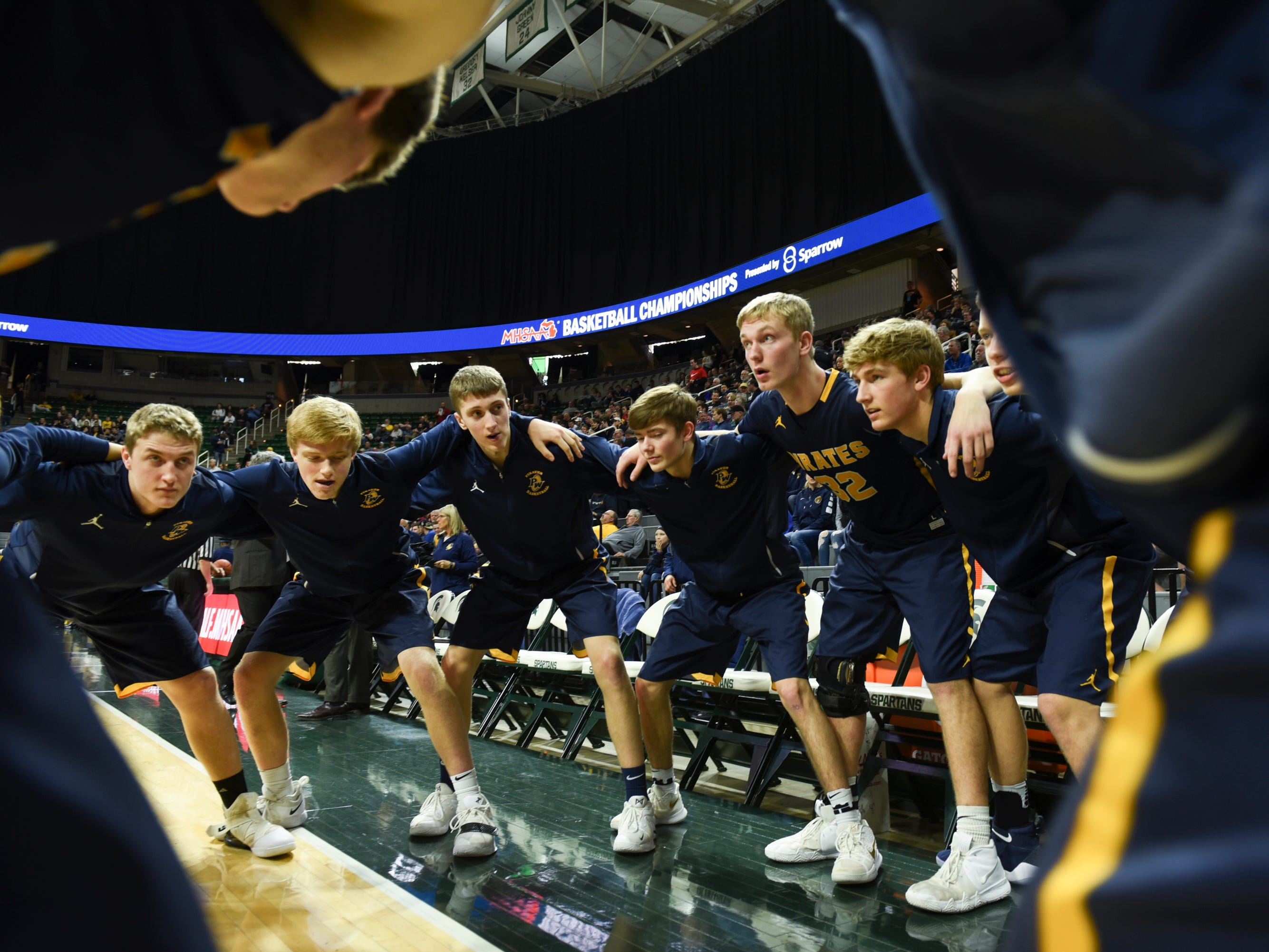 Members of the Pewsamo-Westphalia basketball team huddle up before facing Erie-Mason, Thursday, March 14, 2019, at the MHSAA Div. 3 state semifinal at the Breslin Center in East Lansing.   P-W earned a berth in the state final winning 60-45.