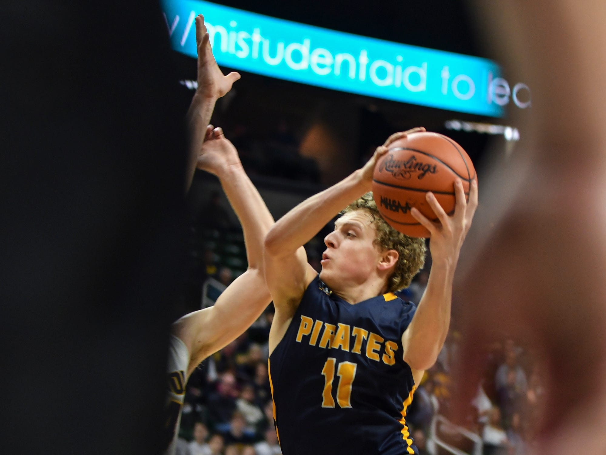 Collin Trierweiler of Pewamo-Westphalia drives into the paint against Erie-Mason, Thursday, March 14, 2019, during the MHSAA Div. 3 state semifinal at the Breslin Center in East Lansing.   P-W earned a berth in the state final winning 60-45.