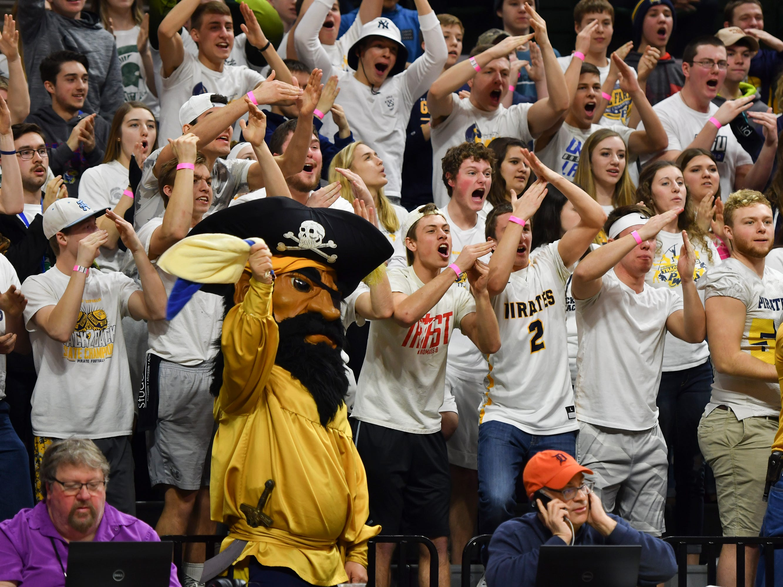 The P-W student section calls for an Erie-Mason technical after a scuffle below the baseline Thursday, March 14, 2019, during the MHSAA Div. 3 state semifinal at the Breslin Center in East Lansing.   P-W earned its berth in the state final beating Erie-Mason 60-45.