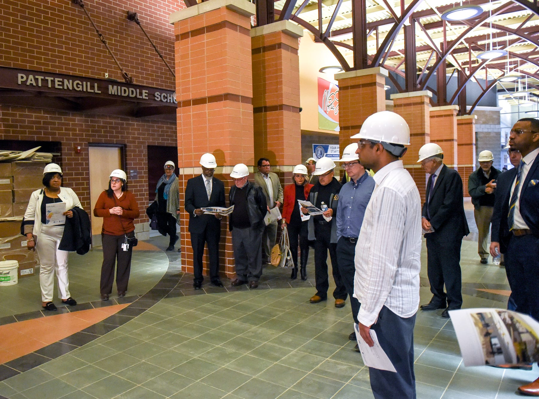 Guests tour of the construction of the new Eastern High School on Thursday, March 14, 2019, in Lansing. The project is being funded by the district's successful Pathway Promise millage, which was passed by voters in 2016. The building was formerly Pattengill Academy.