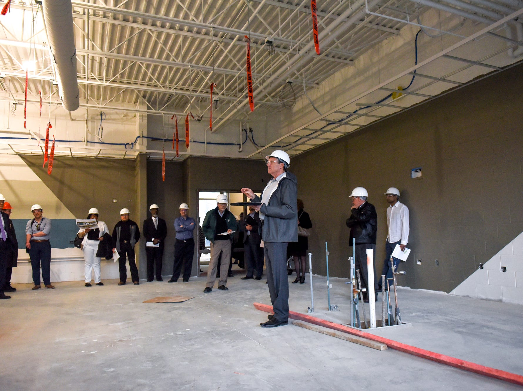 Bob McGraw, building group leader for C2AE, center, talks about the science lab during a tour of the construction of the new Eastern High School on Thursday, March 14, 2019, in Lansing. The project is being funded by the district's successful Pathway Promise millage, which was passed by voters in 2016. The building was formerly Pattengill Academy.