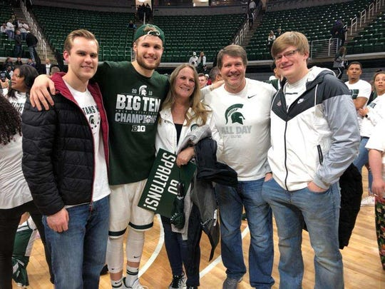 The Ahrens family poses for a photo following Michigan State's victory over Michigan to clinch a share of the Big Ten title. From left to right, Jacob, Kyle, mother Susan, dad Kevin and A.J. (Courtesy of Ahrens family).