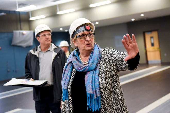 Lansing School District Superintendent Yvonne Caamal Canul talks about the plans of a mural inside the cafeteria during a tour of the construction of the new Eastern High School on Thursday, March 14, 2019, in Lansing. The project is being funded by the district's successful Pathway Promise millage, which was passed by voters in 2016. The building was formerly Pattengill Academy.