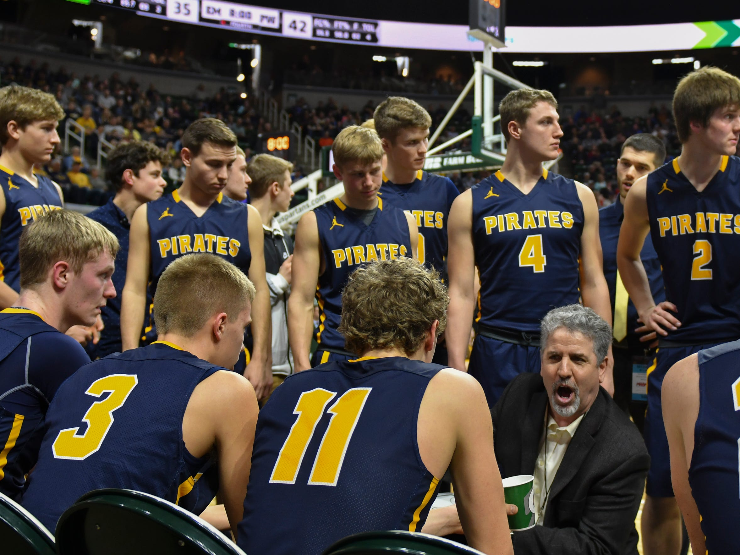 P-W coach Luke Pohl coaches during a timeout against Erie-Mason, Thursday, March 14, 2019, during the MHSAA Div. 3 state semifinal at the Breslin Center in East Lansing.   P-W earned a berth in the state final winning 60-45.