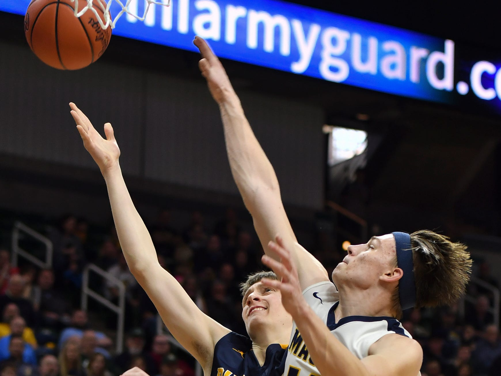 Keegan Smith of P-W drops in two against Erie-Mason's Bryan Sweeney, Thursday, March 14, 2019, during the MHSAA Div. 3 state semifinal at the Breslin Center in East Lansing.   P-W earned a berth in the state final winning 60-45.