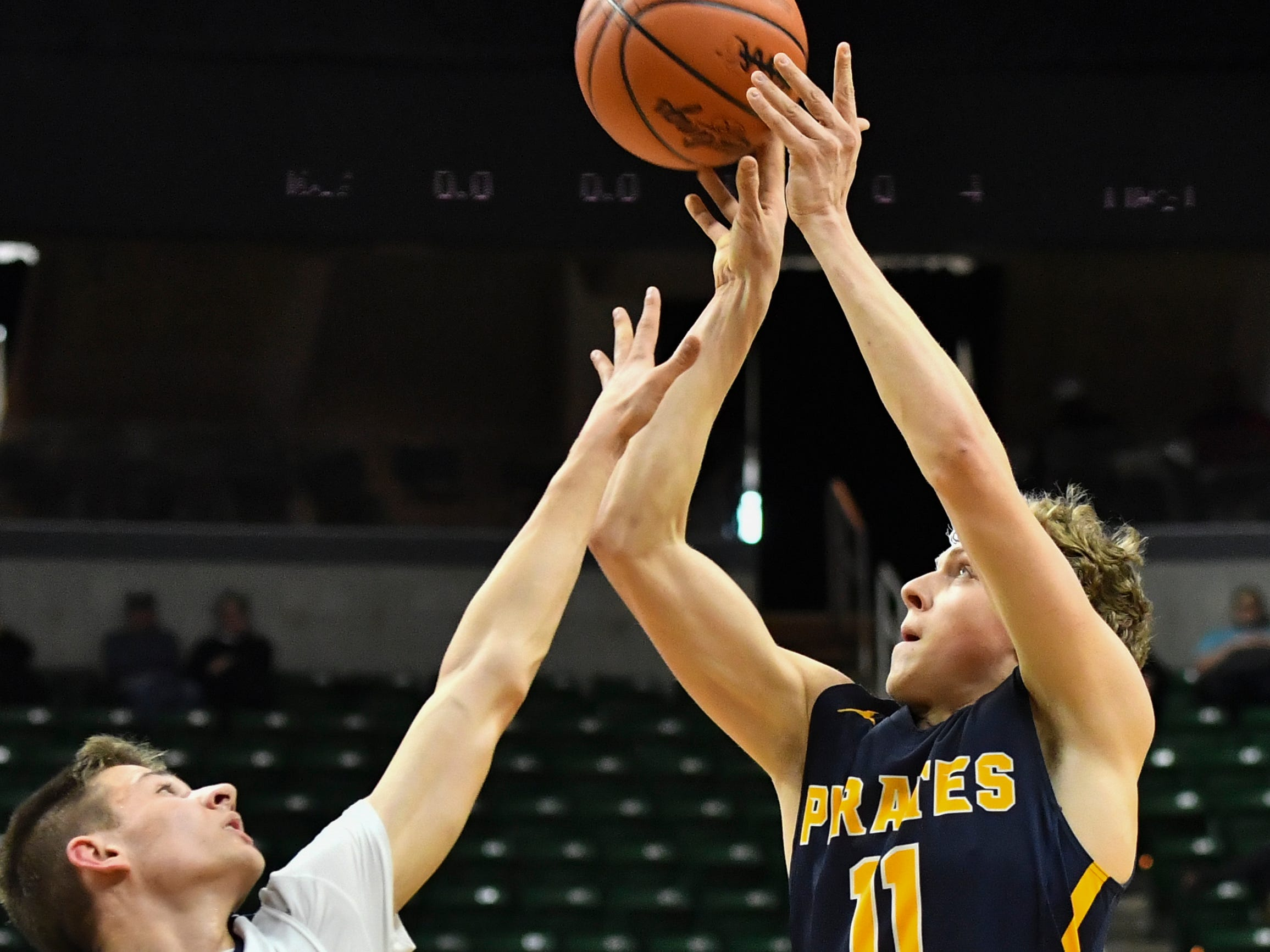 Collin Trierweiler of P-W shoots against Joe Liedel of Erie-Mason, Thursday, March 14, 2019, during the MHSAA Div. 3 state semifinal at the Breslin Center in East Lansing.   P-W earned a berth in the state final winning 60-45.