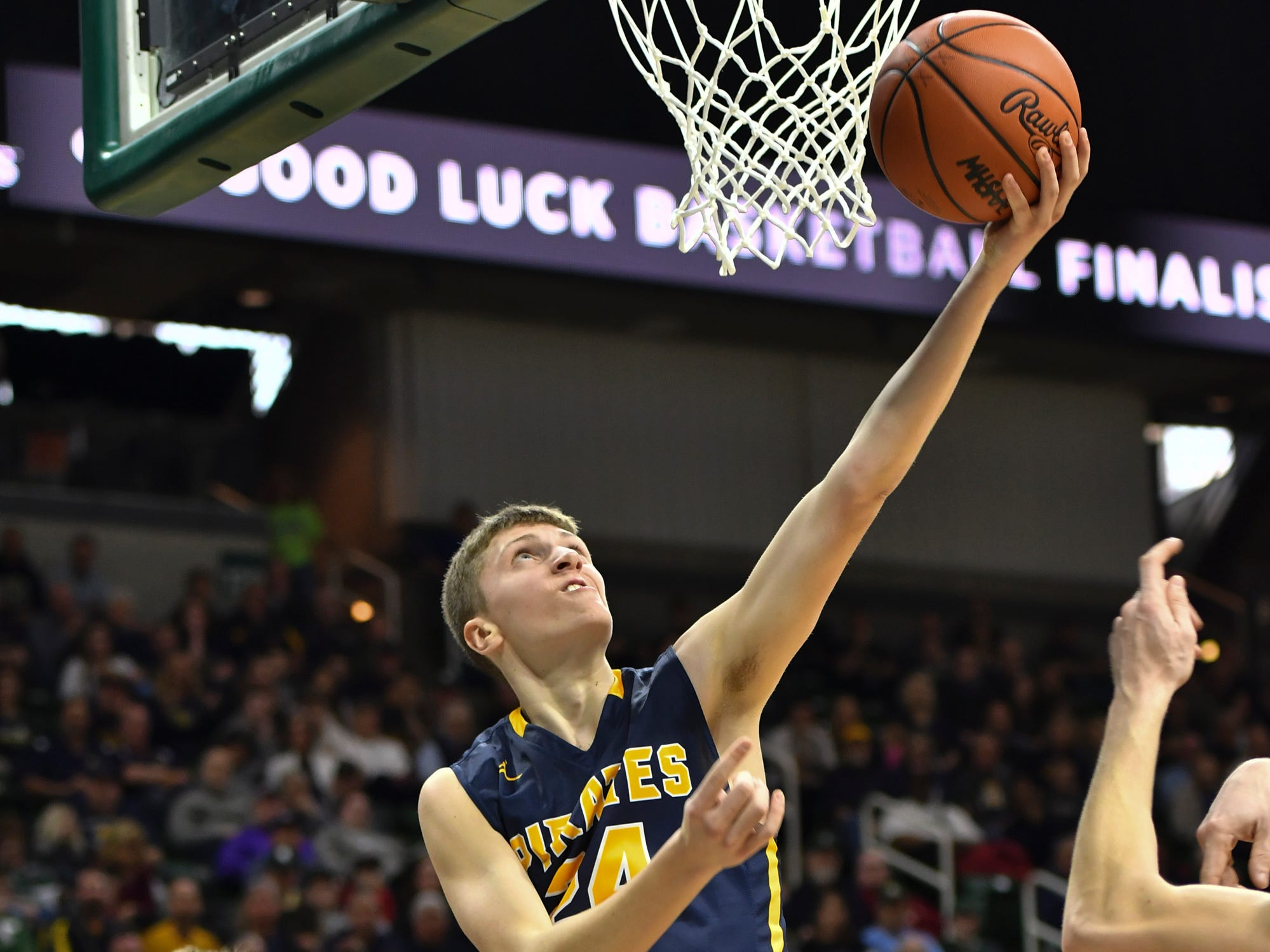 Keegan Smith of Pewamo-Westphalia connects on a reverse layup Thursday, March 14, 2019, against Erie-Mason's John Sweeney during the MHSAA Div. 3 state semifinal at the Breslin Center in East Lansing.   P-W earned a berth in the state final winning 60-45.
