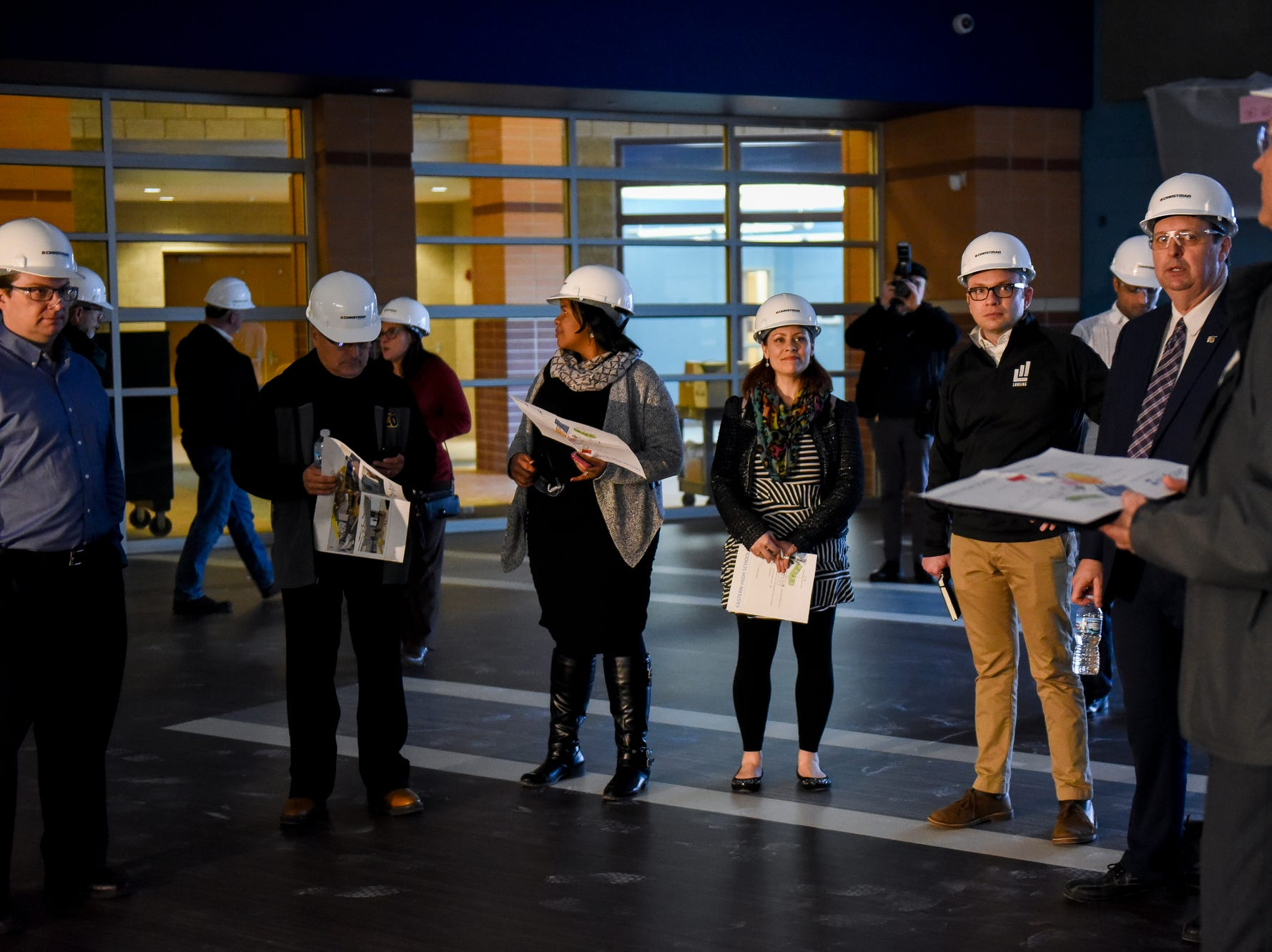 Guests check out the cafeteria during a tour of the construction of the new Eastern High School on Thursday, March 14, 2019, in Lansing. The project is being funded by the district's successful Pathway Promise millage, which was passed by voters in 2016. The building was formerly Pattengill Academy.