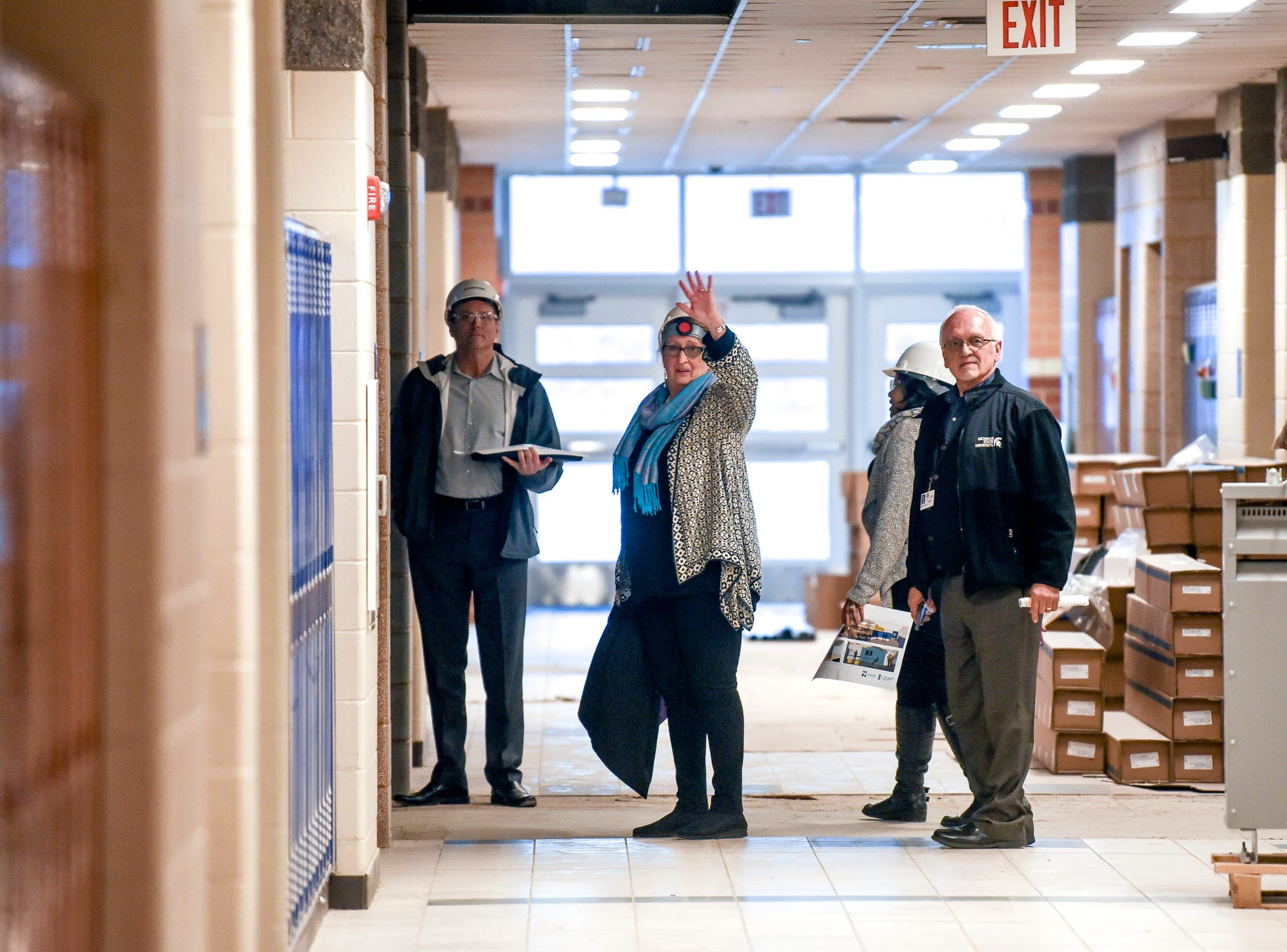 Lansing School District Superintendent Yvonne Caamal Canul, center, waves to guide guests to the science wing during a tour of the construction of the new Eastern High School on Thursday, March 14, 2019, in Lansing. The project is being funded by the district's successful Pathway Promise millage, which was passed by voters in 2016. The building was formerly Pattengill Academy.