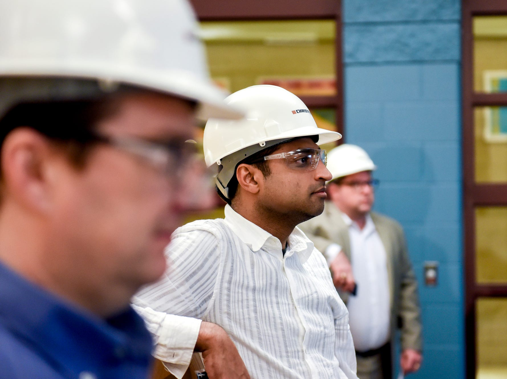 Lansing School District Board of Education Trustee Dr. Farhan Bhatti looks on during a tour of the construction of the new Eastern High School on Thursday, March 14, 2019, in Lansing. The project is being funded by the district's successful Pathway Promise millage, which was passed by voters in 2016. The building was formerly Pattengill Academy.