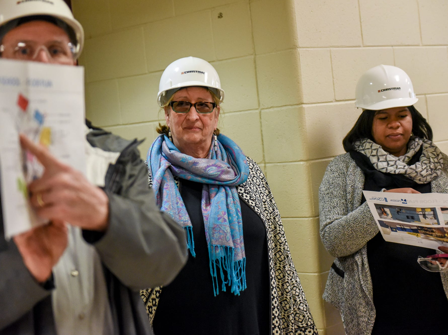 Lansing School District Superintendent Yvonne Caamal Canul, center, and Lansing School District Board President Rachel Lewis, right, listen as Bob McGraw, building group leader for C2AE, talks during a tour of the construction of the new Eastern High School on Thursday, March 14, 2019, in Lansing. The project is being funded by the district's successful Pathway Promise millage, which was passed by voters in 2016. The building was formerly Pattengill Academy.
