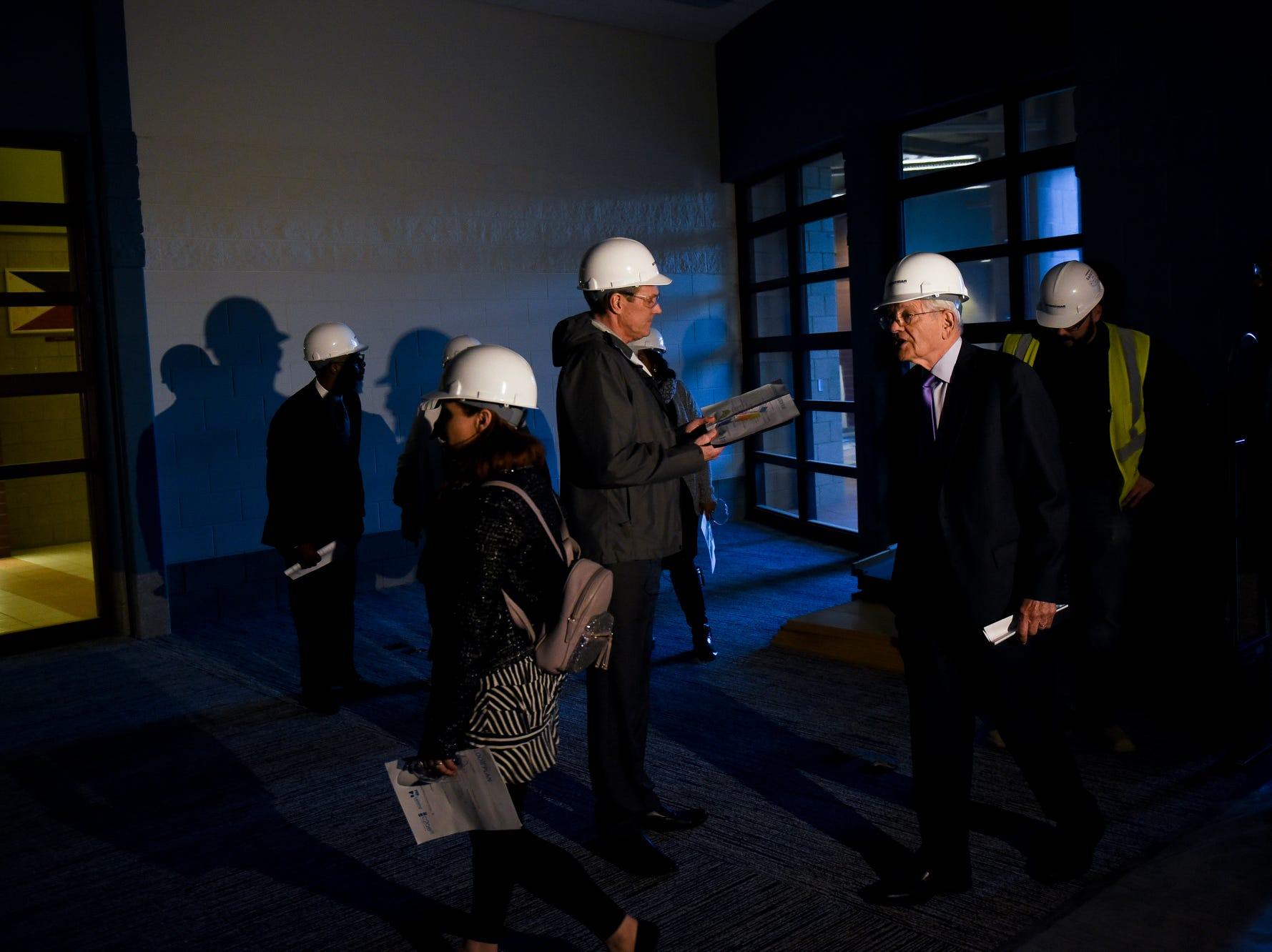 Guests tour the library during a tour of the construction of the new Eastern High School on Thursday, March 14, 2019, in Lansing. The project is being funded by the district's successful Pathway Promise millage, which was passed by voters in 2016. The building was formerly Pattengill Academy.