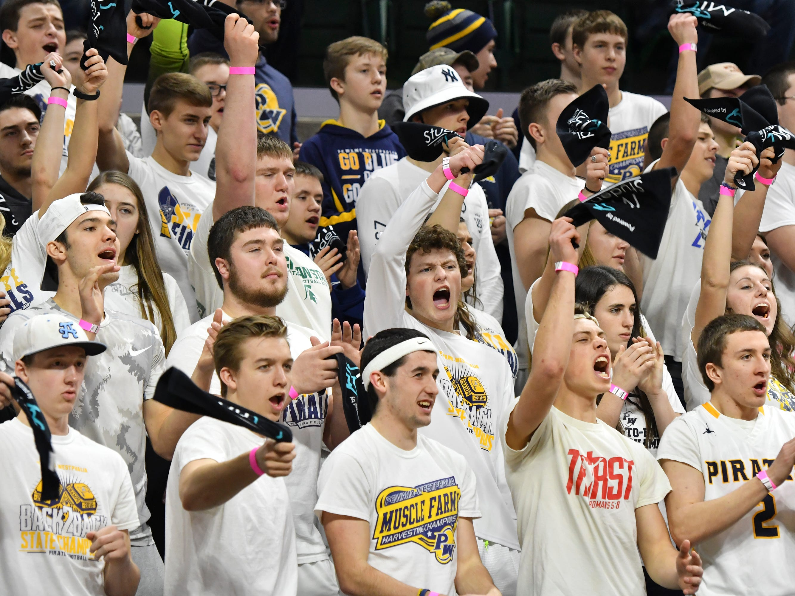 P-W fans cheer on their Pirates against Erie-Mason, Thursday, March 14, 2019, during the MHSAA Div. 3 state semifinal at the Breslin Center in East Lansing.   P-W earned a berth in the state final winning 60-45.