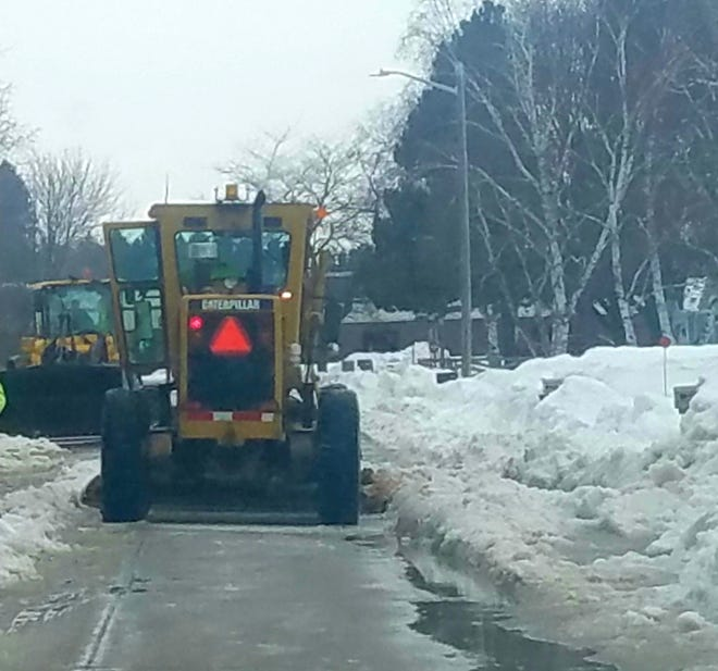Public Works crews work to clear streets in Two Rivers.