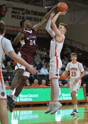 Willard's Davon Triplett, who will be playing in the 41st News Journal All-Star Classic on March 29 at Lexington High School, blocks a shot by Coldwater's Marcus Bruns during Wednesday's Division III regional semifinal game in Bowling Green's Stroh Center.