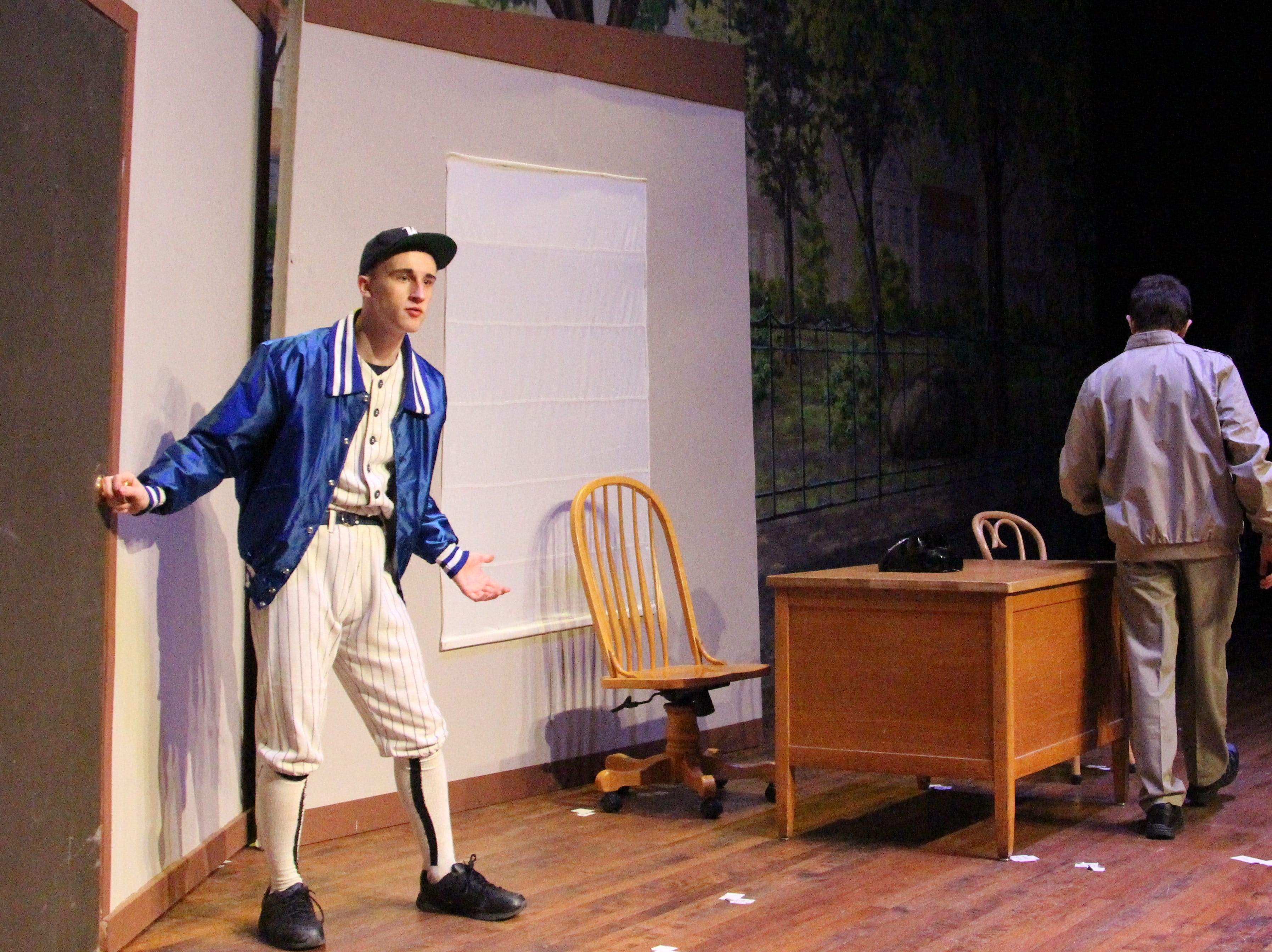 """Ryan Roth joins the scene during a Wednesday dress rehearsal of """"Damn Yankees"""" as hardworking  baseball manager Van Buren. The show is slated for this weekend at the Marion Palace Theatre."""