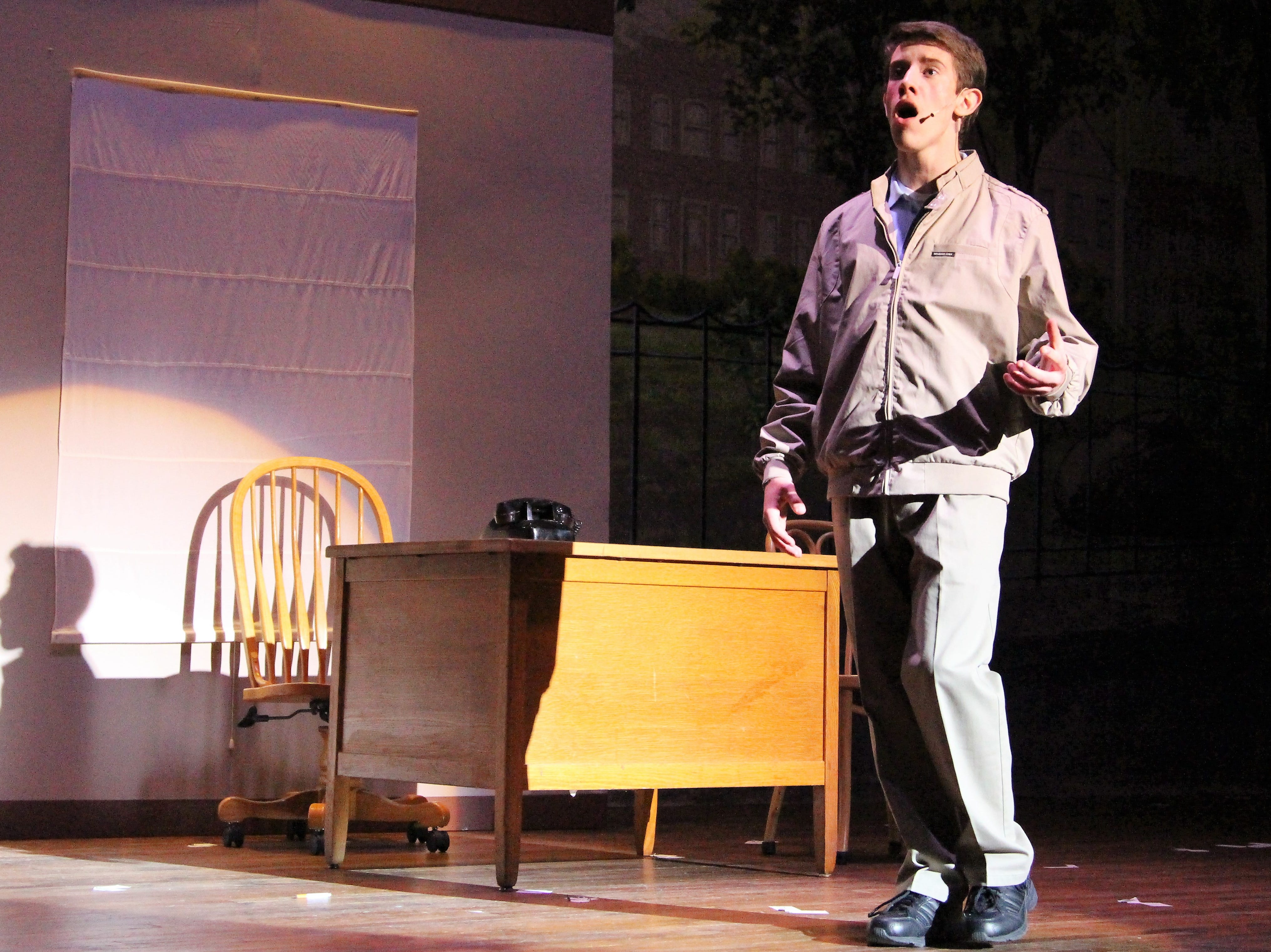 """Zach Abraham takes the Palace's stage on Wednesday as the Washington Senator's home-run slugger Joe Hardy during Pleasant High School's production of the baseball themed musical """"Damn Yankees."""""""