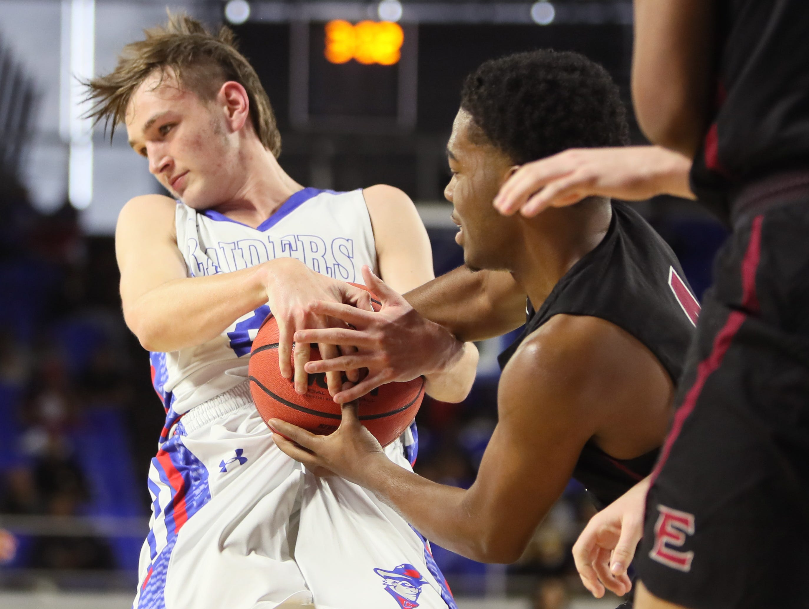 Memphis East's Isaiah Cathey battles for the ball with Cleveland's Klay McGowan during the TSSAA Division I basketball state tournament at the Murphy Center in Murfreesboro, Tenn. on Thursday, March 14, 2019.