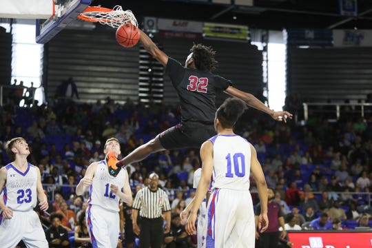 Memphis East's James Wiseman dunks the ball against Cleveland during the TSSAA Division I basketball state tournament at the Murphy Center in Murfreesboro, Tenn. on Thursday, March 14, 2019.