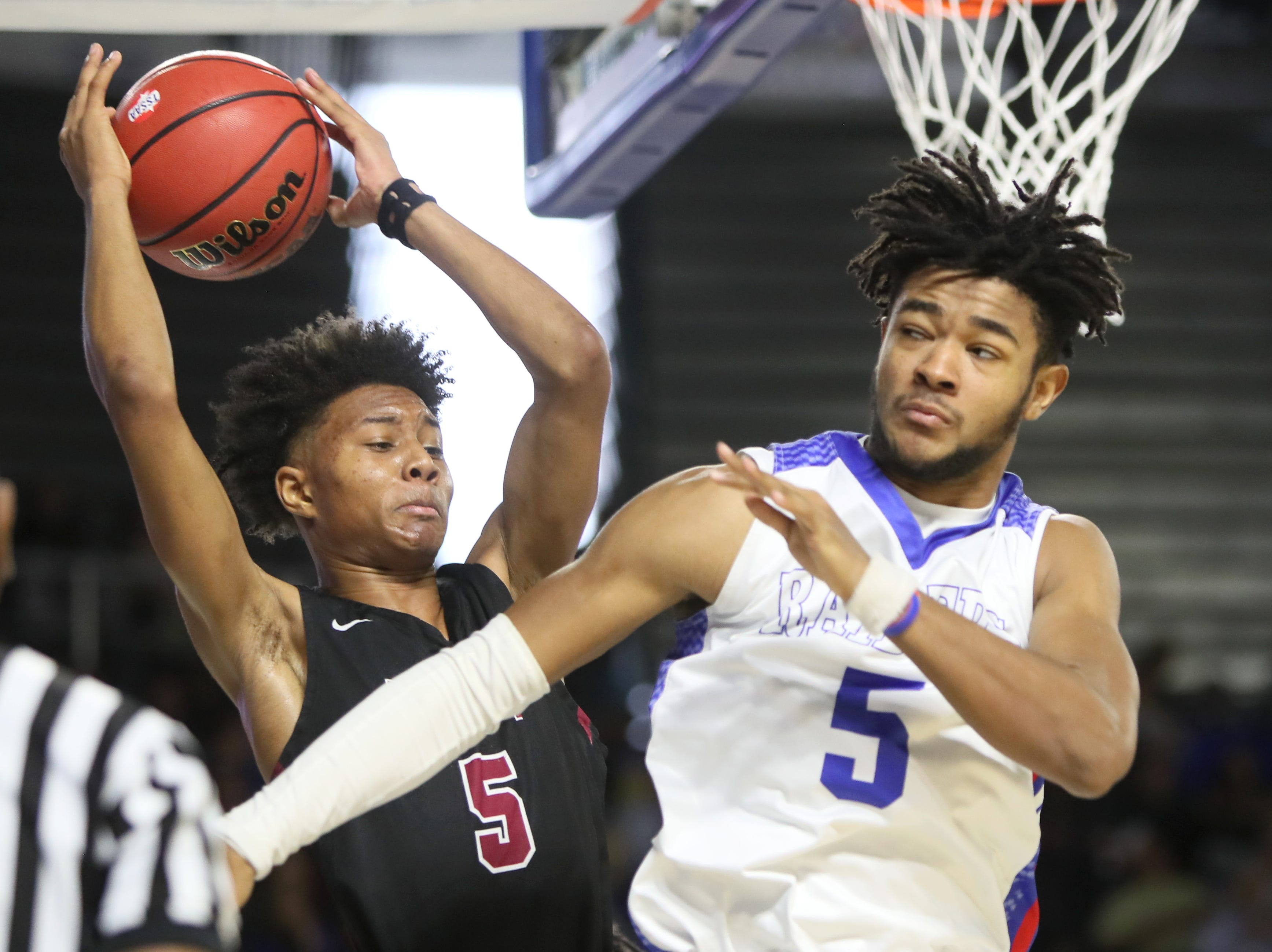 Memphis East's Tadarius Jacobs throws the ball off Cleveland's Darius Howard while falling out of bounds during the TSSAA Division I basketball state tournament at the Murphy Center in Murfreesboro, Tenn. on Thursday, March 14, 2019.
