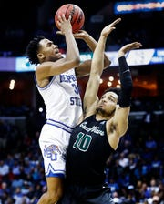 Memphis guard Jeremiah Martin (left) is fouled by Tulane's Caleb Daniels (right) during Thursday's game.