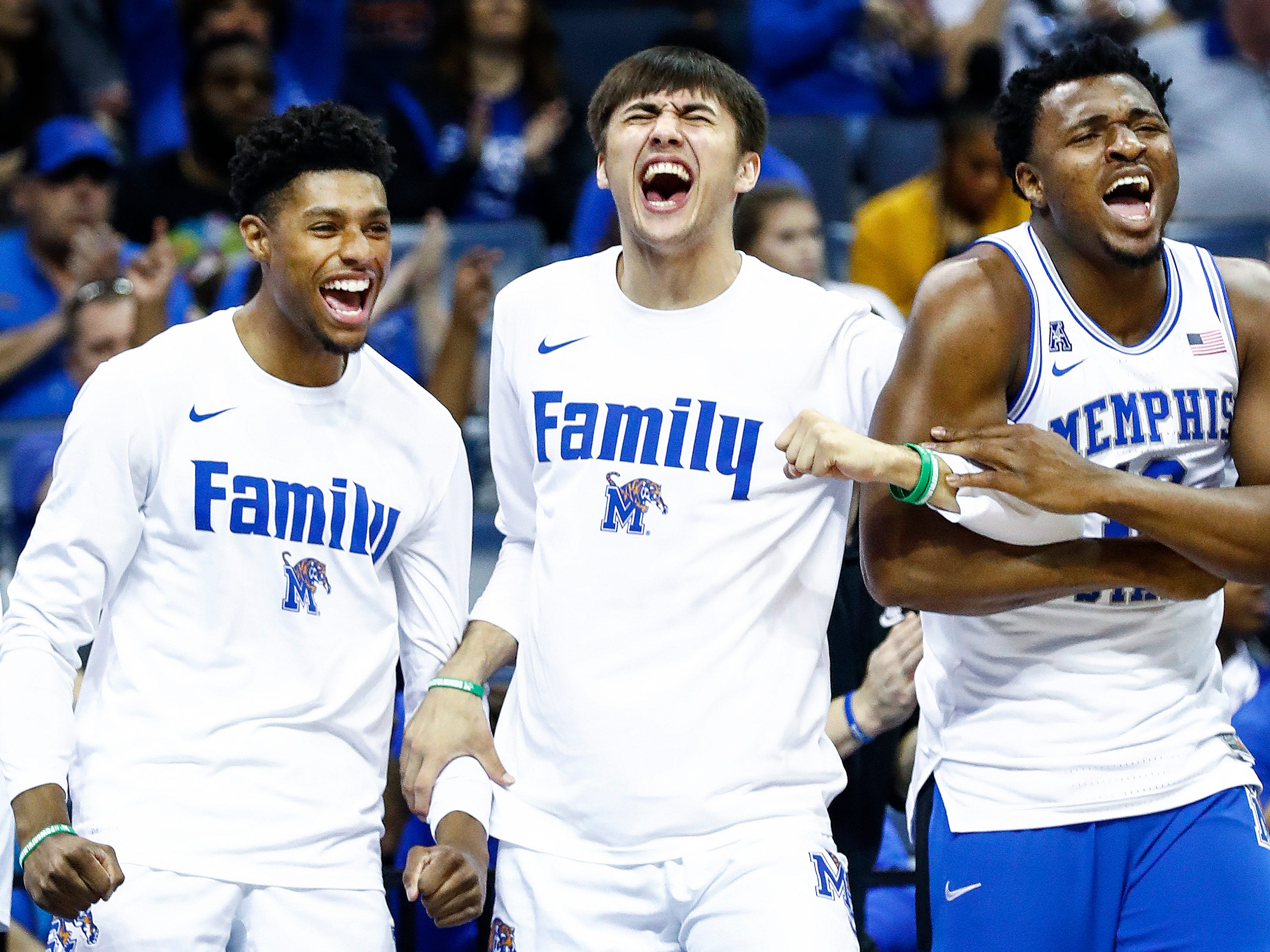 Memphis teammates (left to right) Ryan Boyce, David Wingett and Victor Enoh celebrate during a 83-68 victory over Tulane in their first round AAC Tournament game at the  FedExForum, Thursday, March 14, 2019.