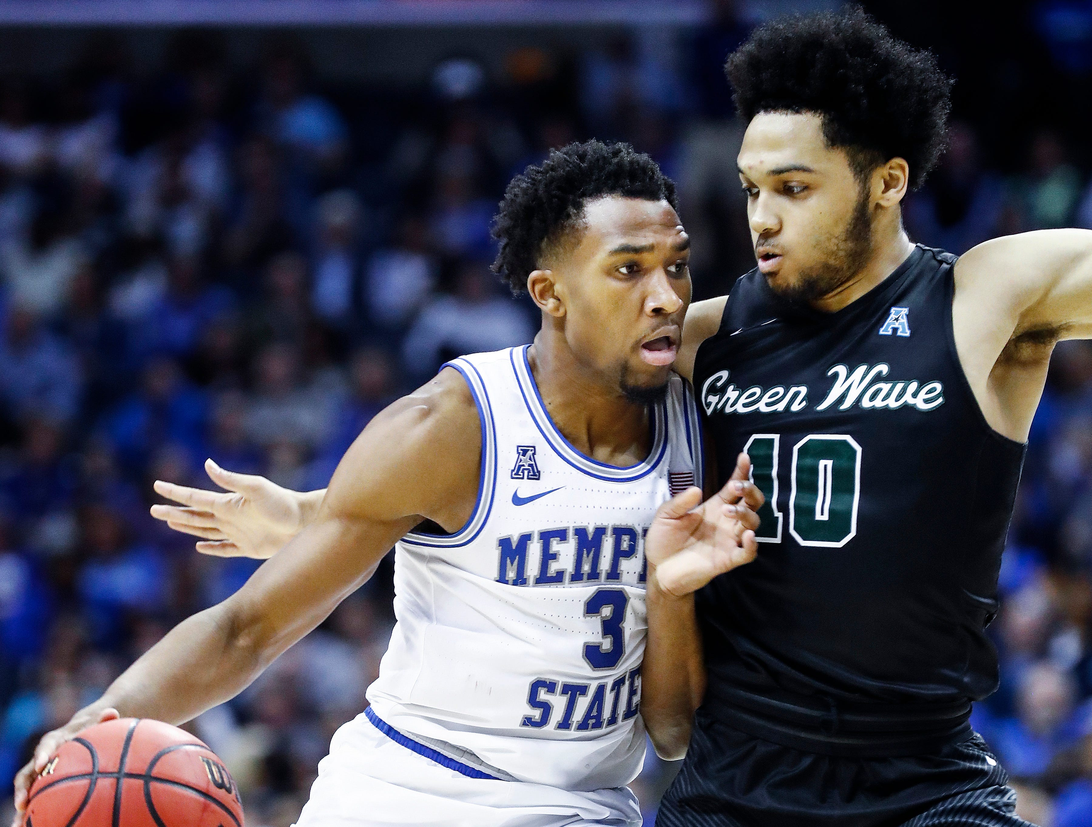 Memphis guard Jeremiah Martin (left) drives the lane against Tulane defender Caleb Daniels (right) during action of their first round AAC Tournament game at the  FedExForum, Thursday, March 14, 2019.